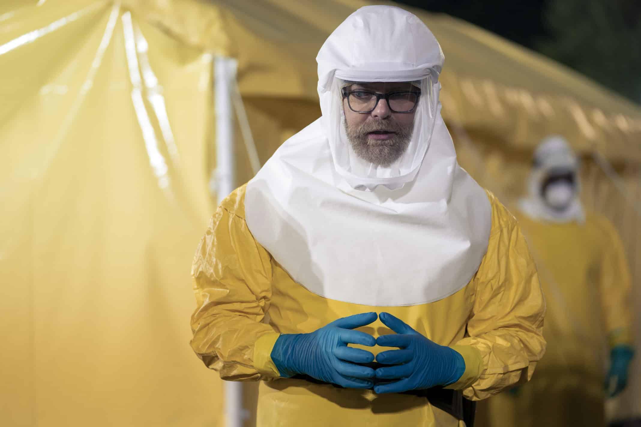 Dr. Michael Stevens (Rainn Wilson) in a hazmat suit.