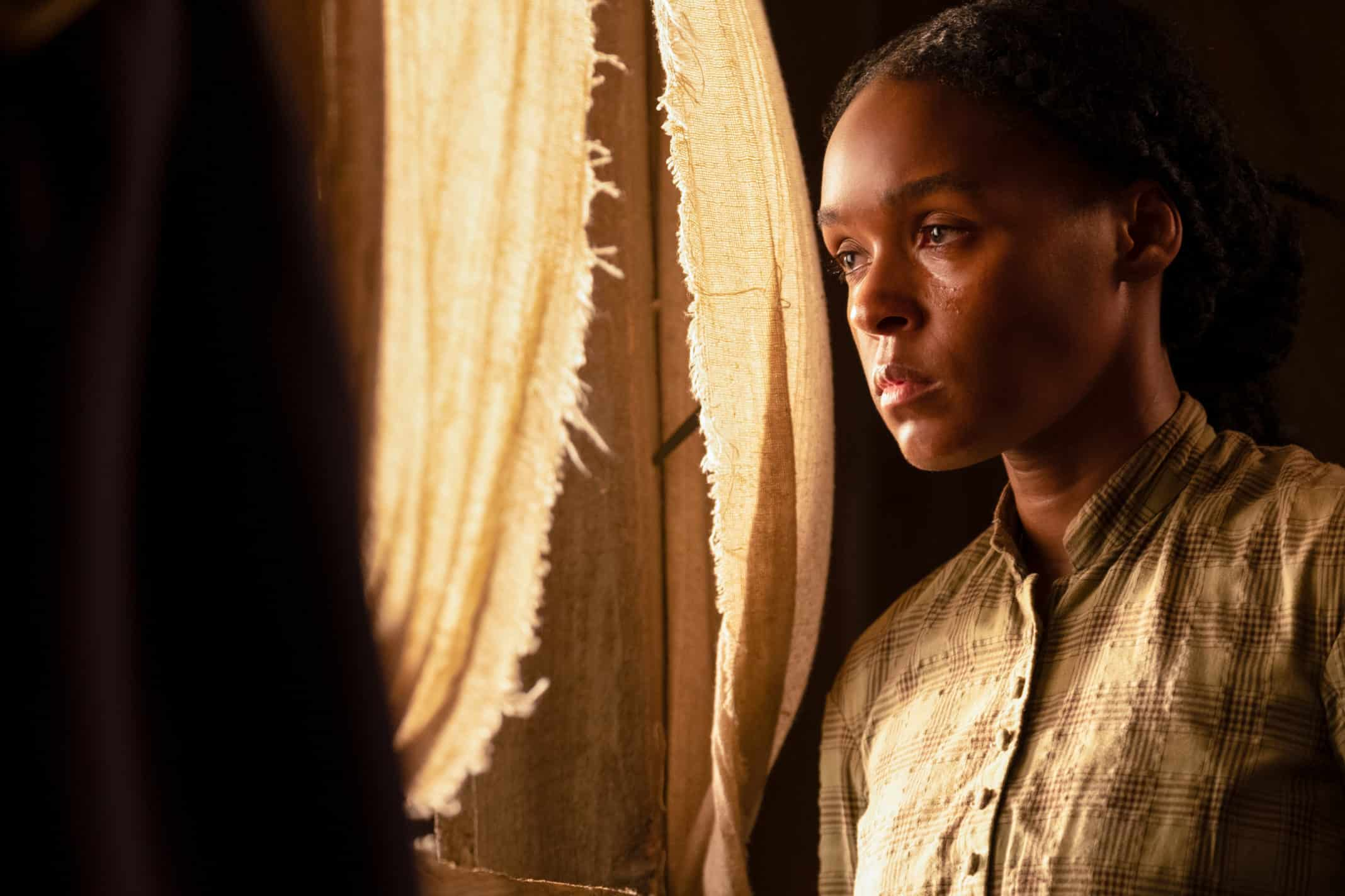 Janelle Monae as Eden looking out a window.