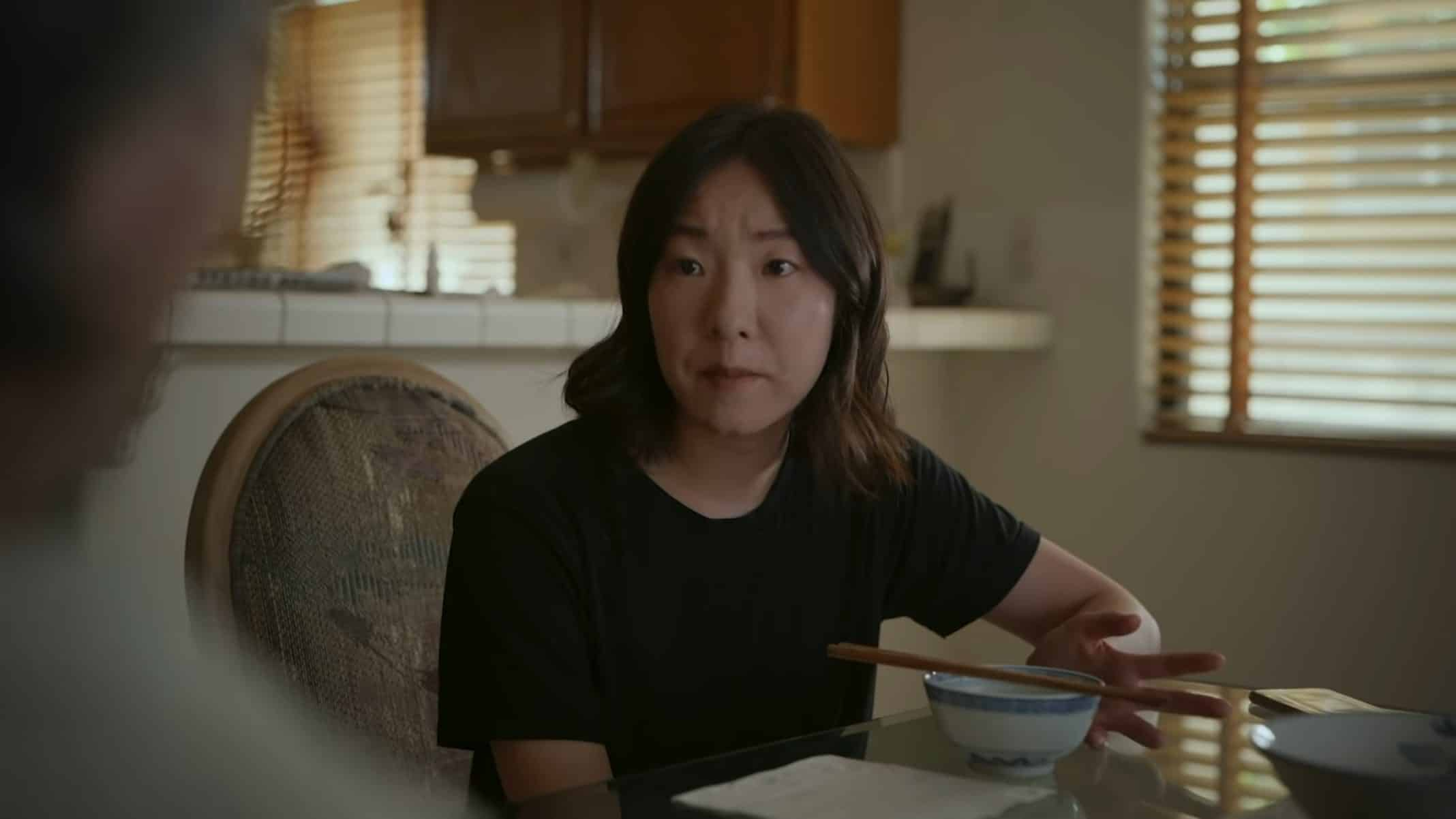 Emma (Chanelle Wang) at her father's dining table.