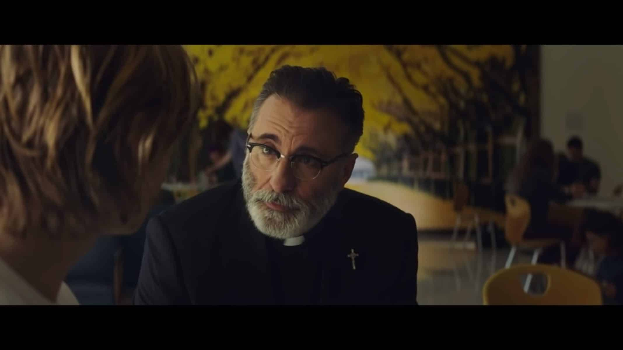 Father Patrick (Andy Garcia) talking to Adam.