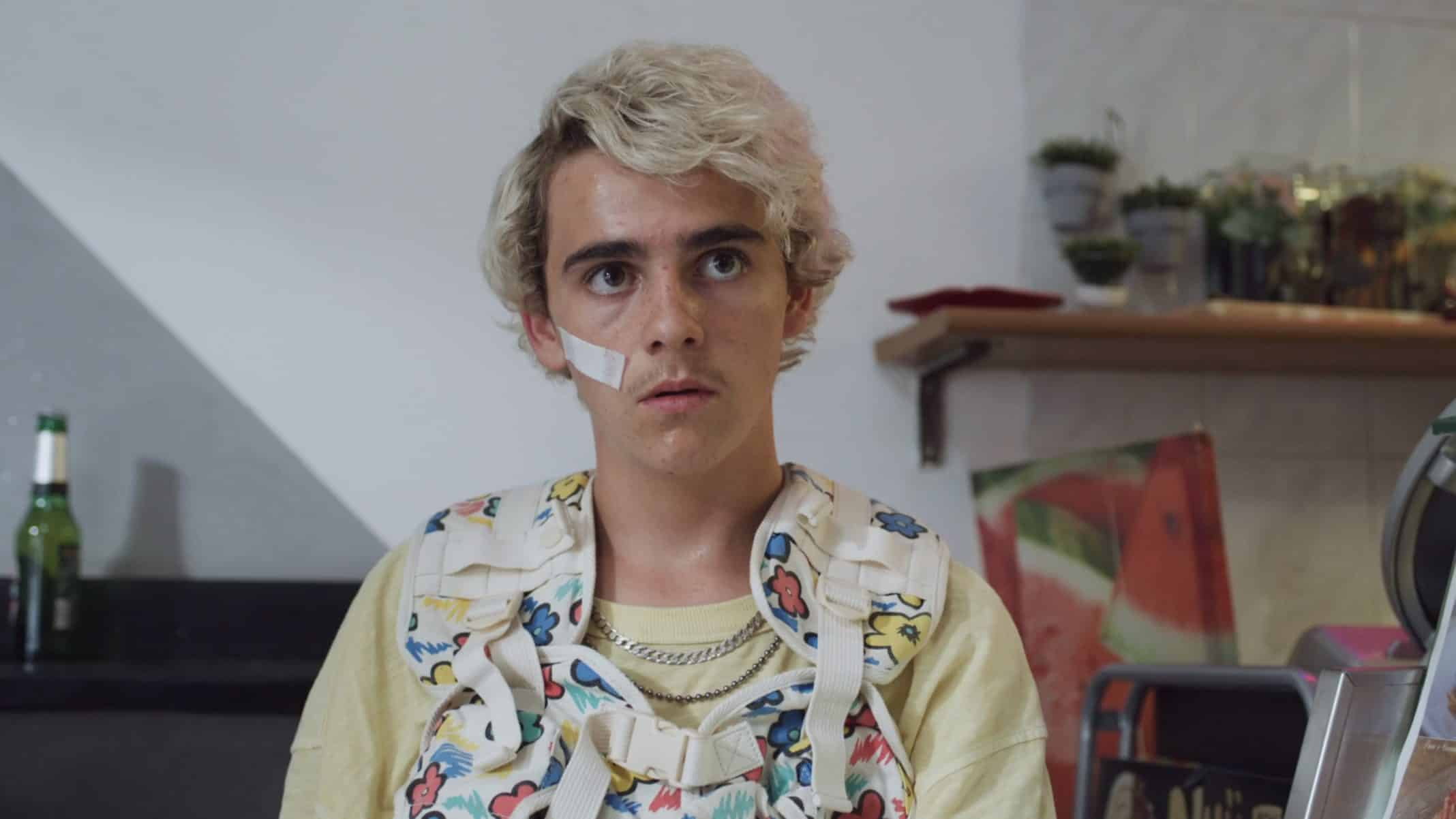 Fraser (Jack Dylan Grazer) in a colorful vest.