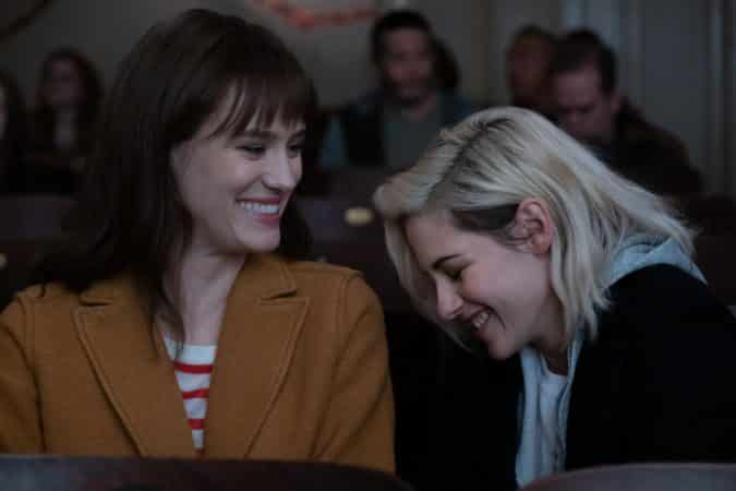 Abby (KRISTEN STEWART, right) and Harper (MACKENZIE DAVIS) enjoy a moment at the movies