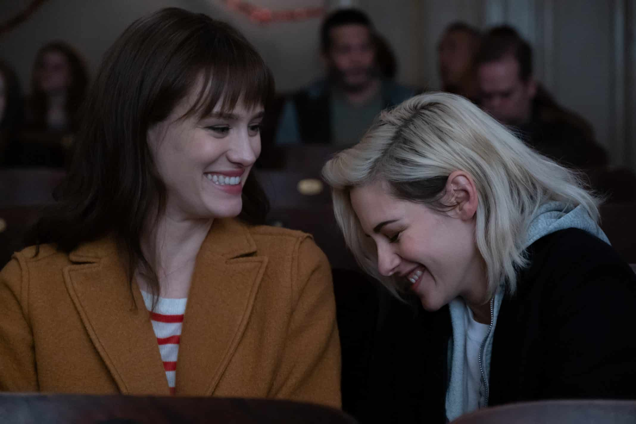 Abby (KRISTEN STEWART, right) and Harper (MACKENZIE DAVIS) enjoy a moment at the movies