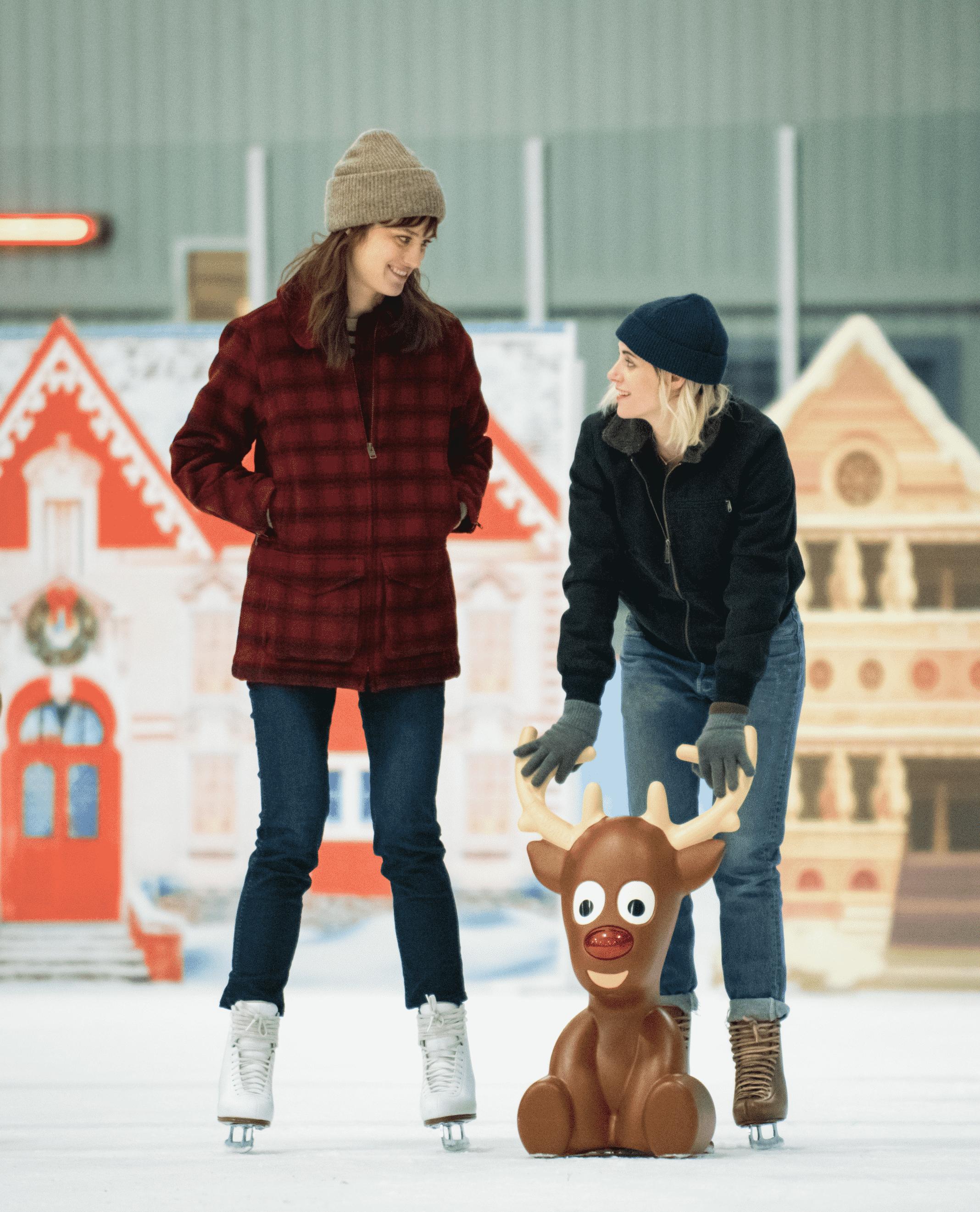 Abby (KRISTEN STEWART, right) and Harper (MACKENZIE DAVIS) enjoy a moment on the ice