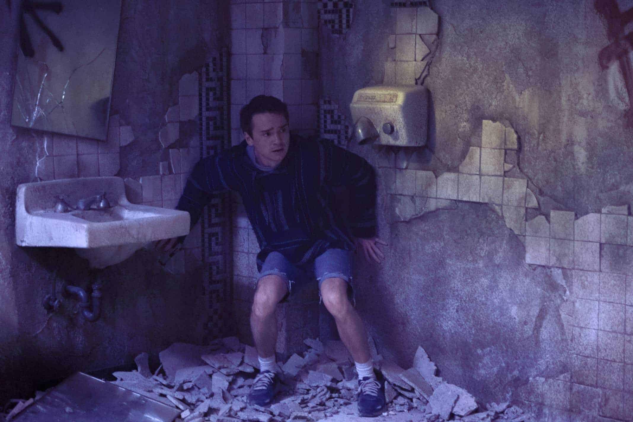 Ian (Dan Byrd) in a terrible looking bathroom.