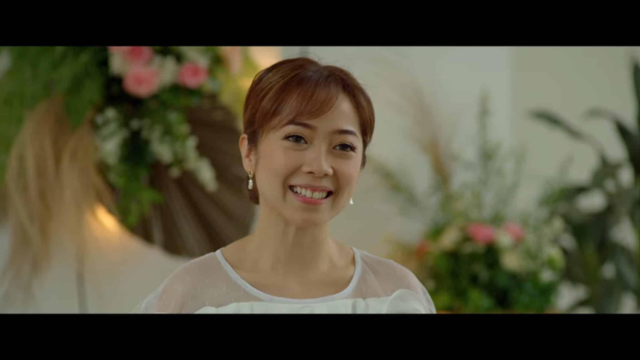 Julia (Jarina Salim) in a white dress.
