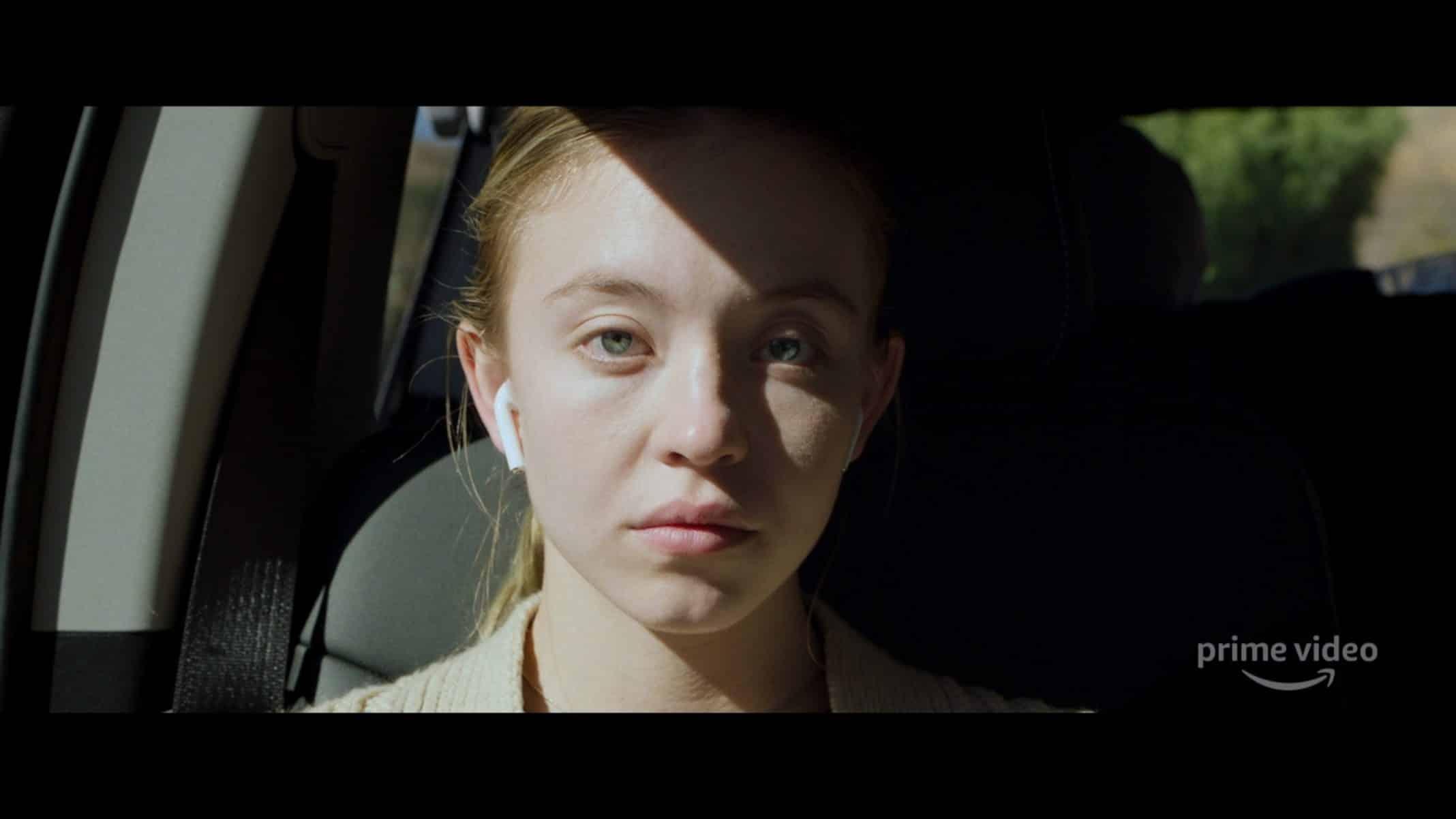 Juliet (Sydney Sweeney) sitting in the car