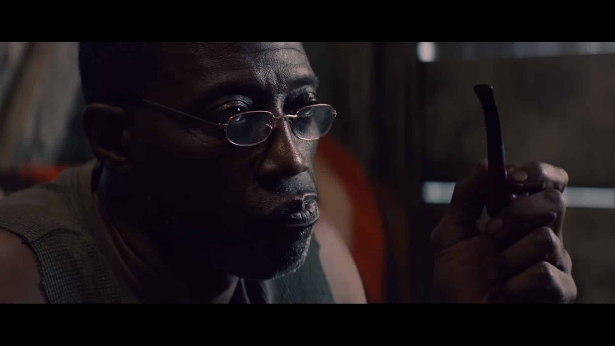 Lawrence (Wesley Snipes) smoking from his pipe.