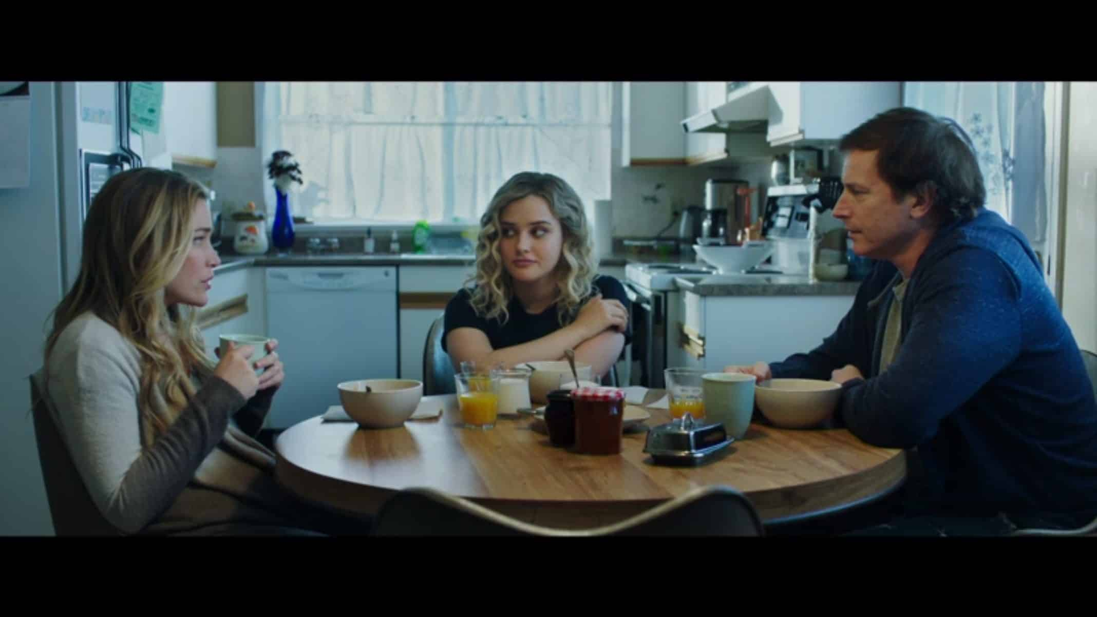 Mara's Mom (Piper Perabo), Mara (Katherine Langford), and Mara's Dad (Rob Huebel) at the kitchen room table together.