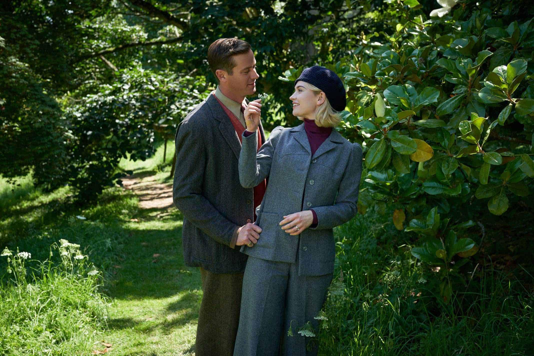 Armie Hammer as Maxim de Winter, Lily James as Mrs. de Winter.
