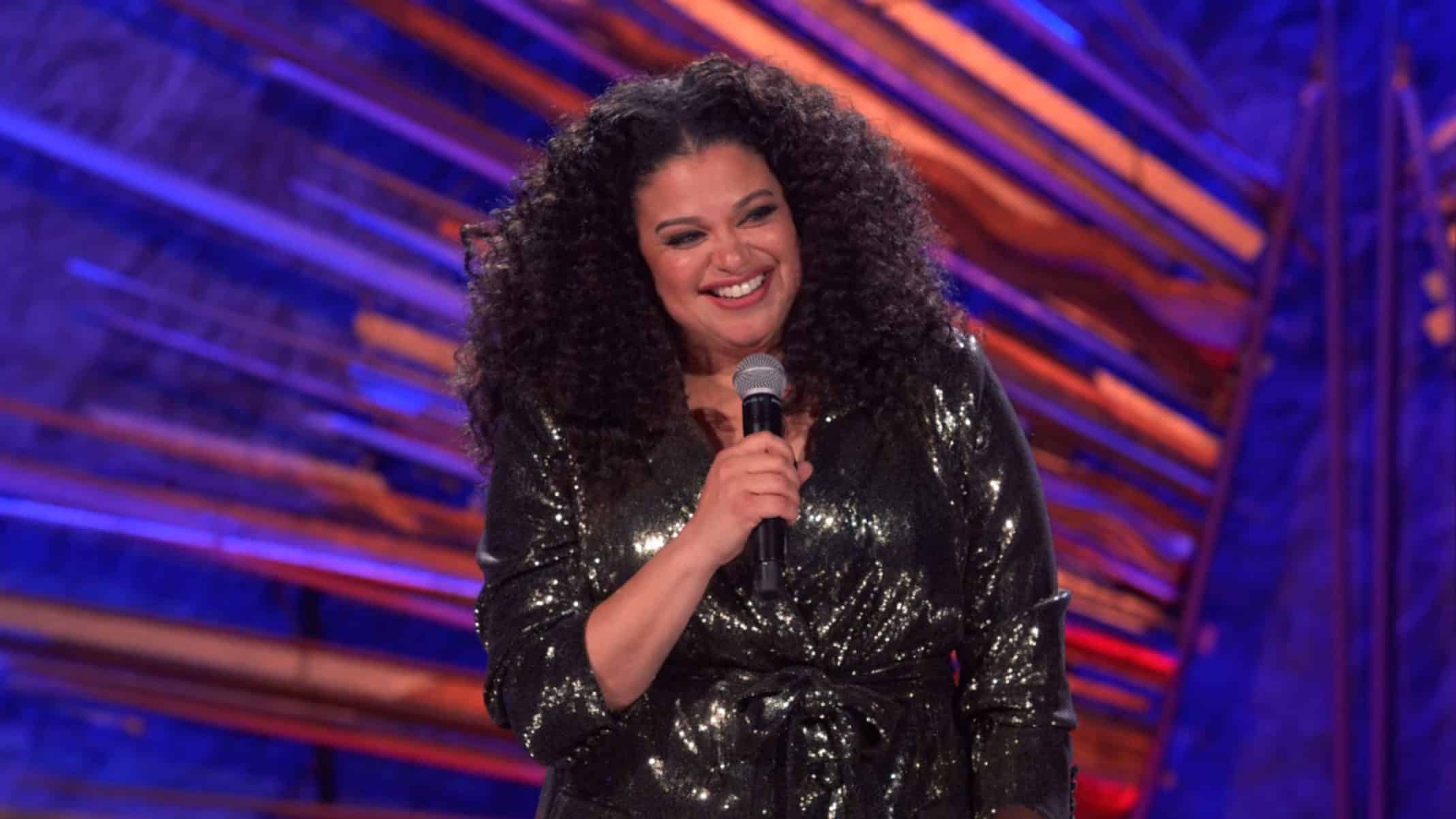 Michelle Buteau smiling brightly.