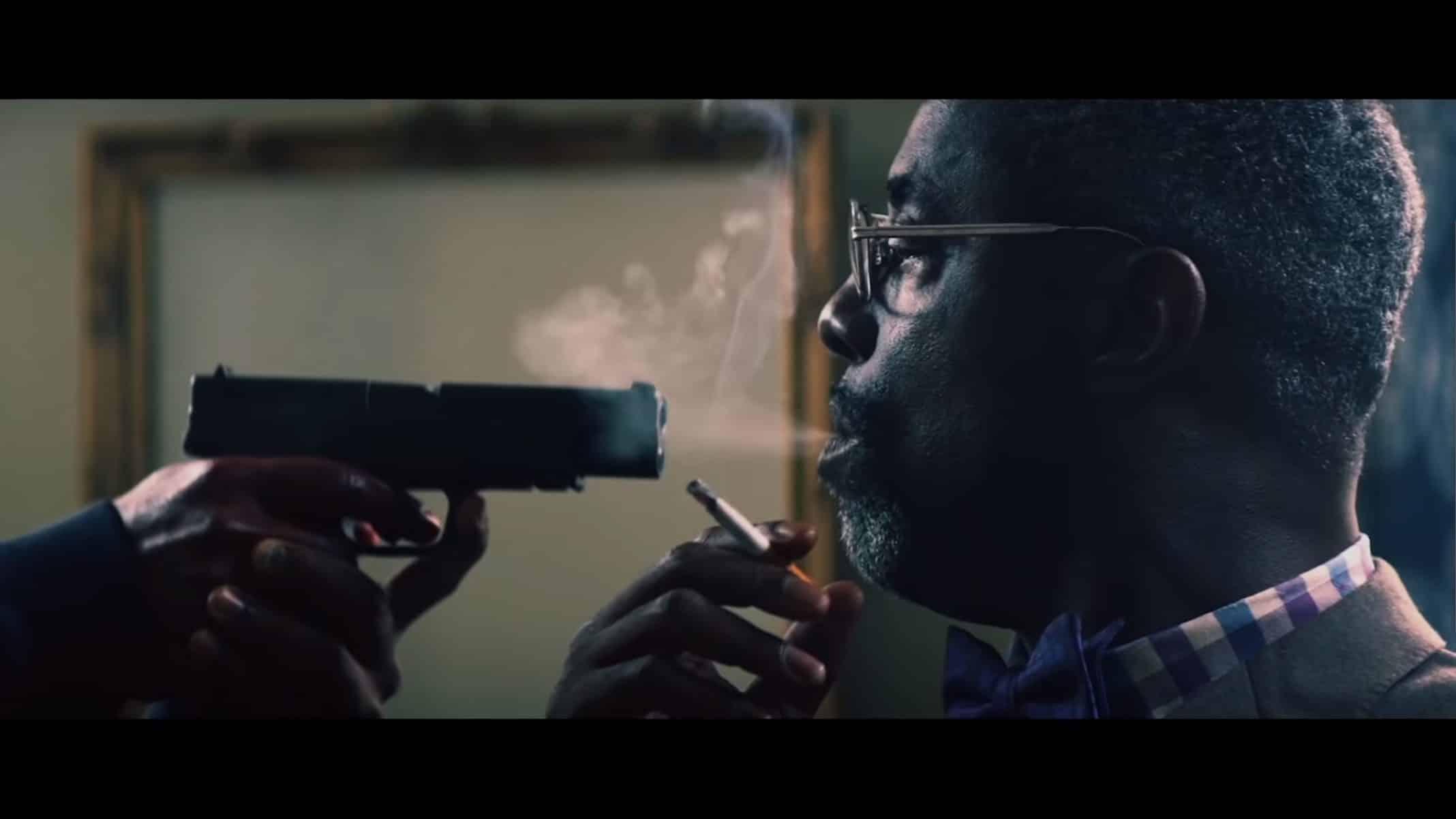 Sinclair Stewart (Isiah Washington) with a gun in his face.