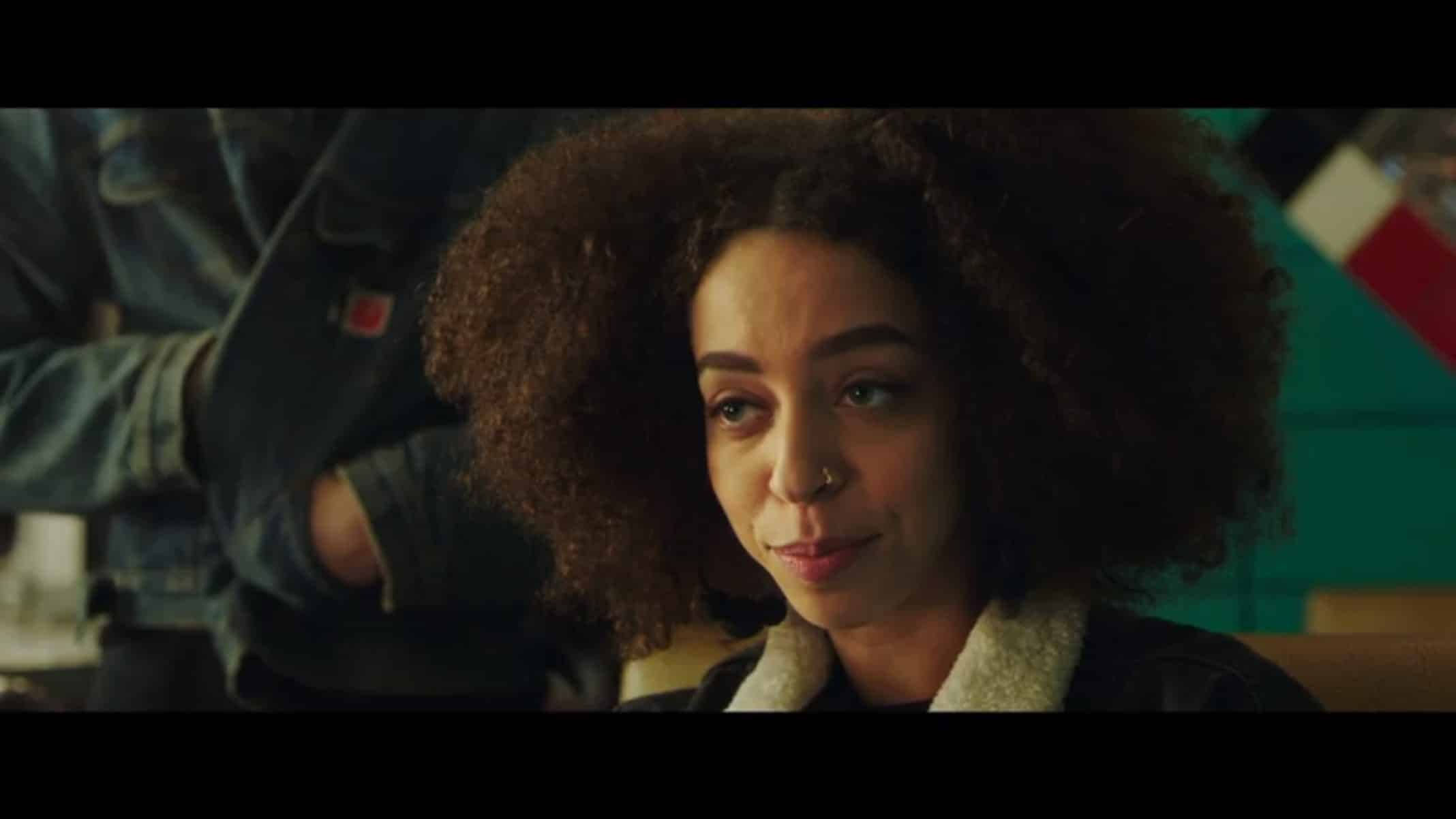 Tess (Hayley Law) taking note a boy is behind her.