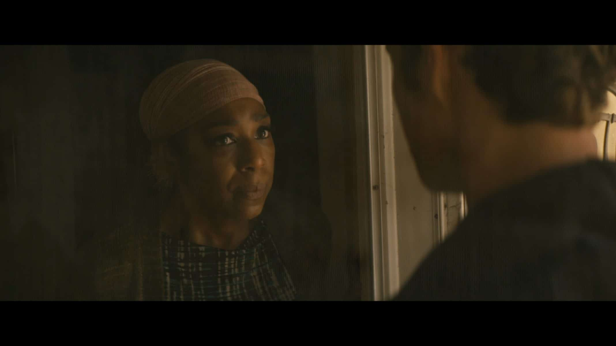 Valerie (Dawnn Lewis) talking to Hughie through a screen.