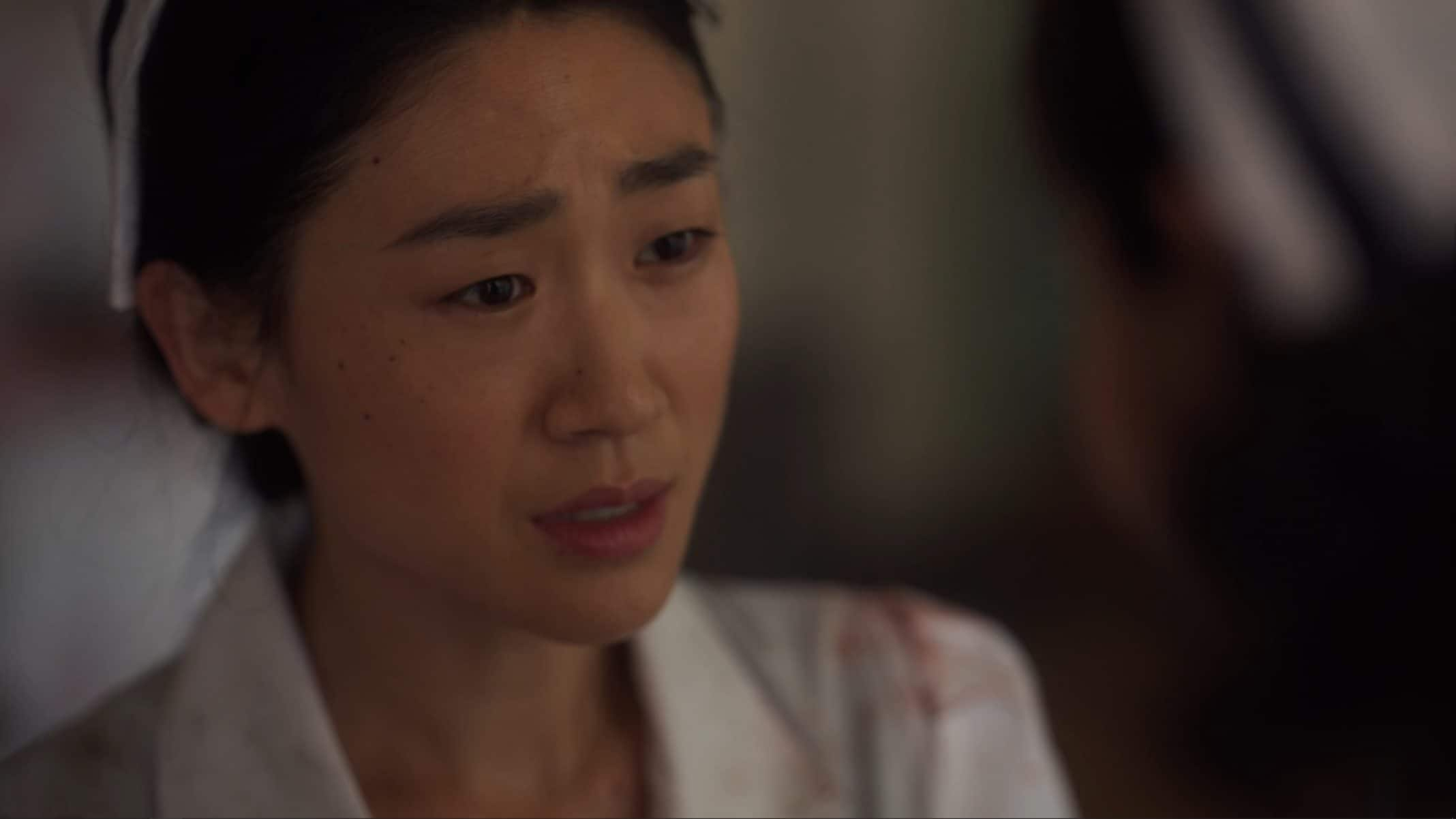 Young-Ja Unni (Prisca Kim) looking worried.