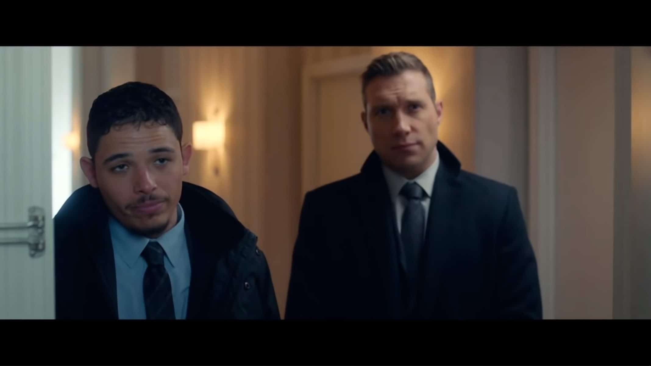 Agent Hall (Anthony Ramos) and Agent Nivens (Jai Courtney) meeting Tom.