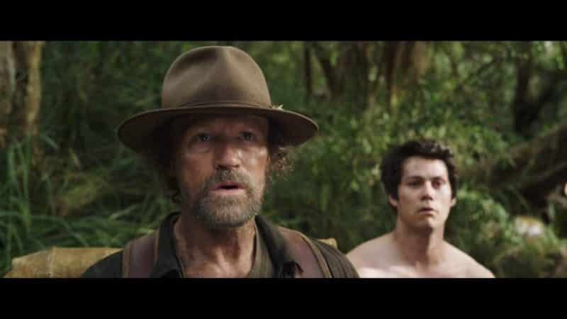 Clyde (Michael Rooker) and Joel (Dylan O'Brien) looking at something.