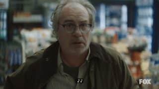 Dr. Weiss (John Billingsley) on the run, realizing he has been seen.