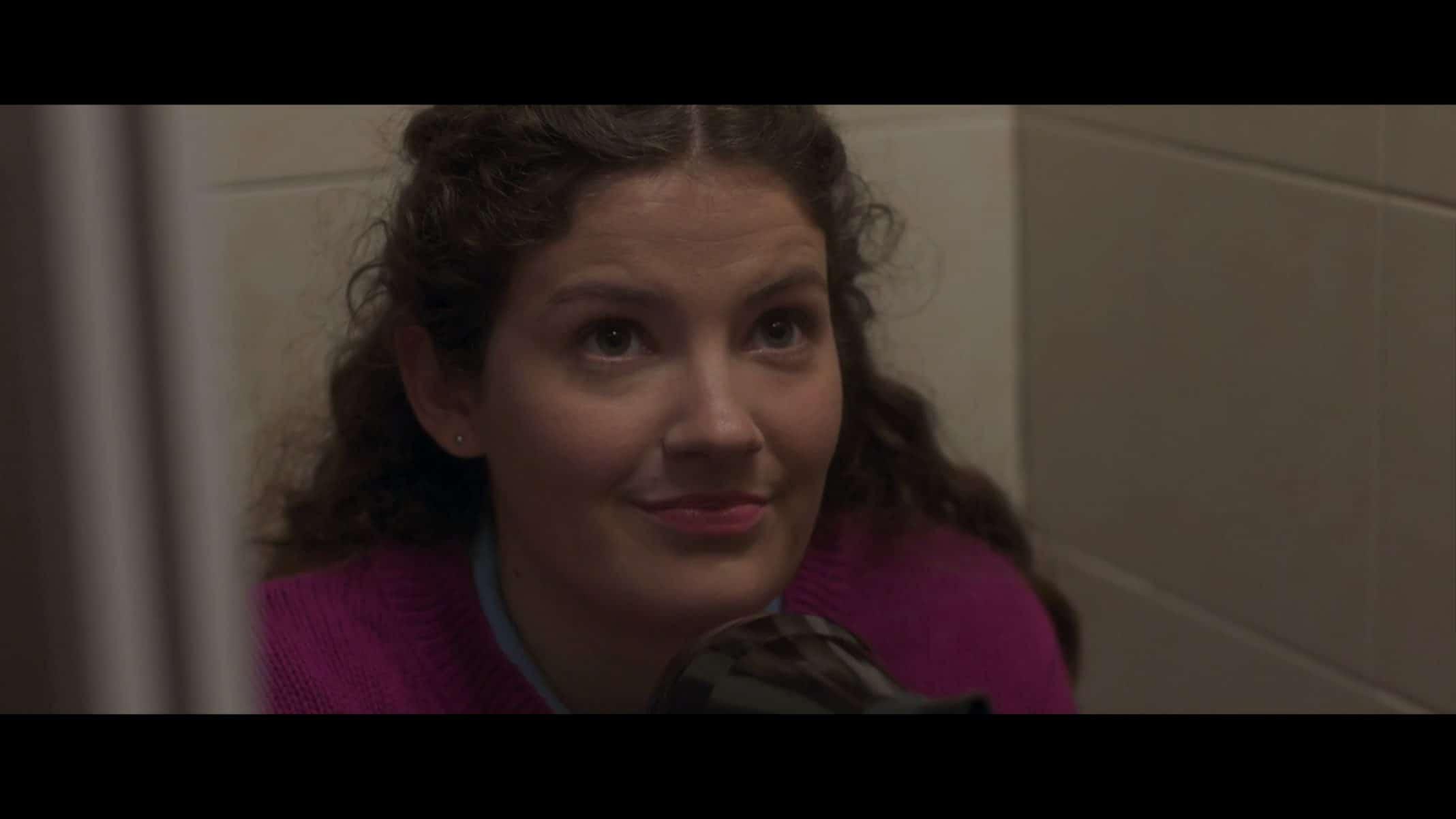 Ellie (Sophie Hawkshaw) threatening Tara with a hairdryer.