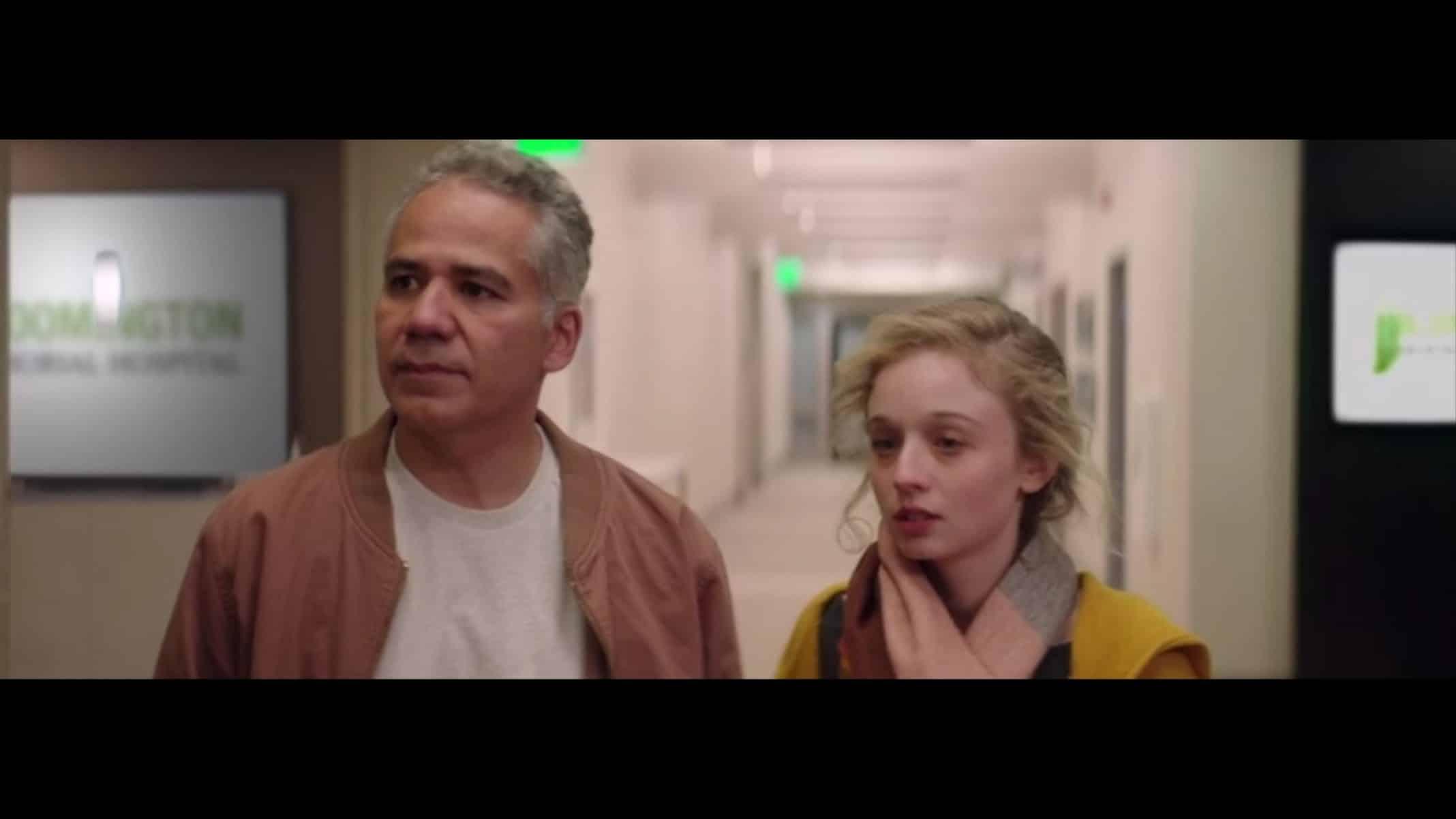 Gary (John Ortiz) and Nora (Carson Meyer) in a hospital.