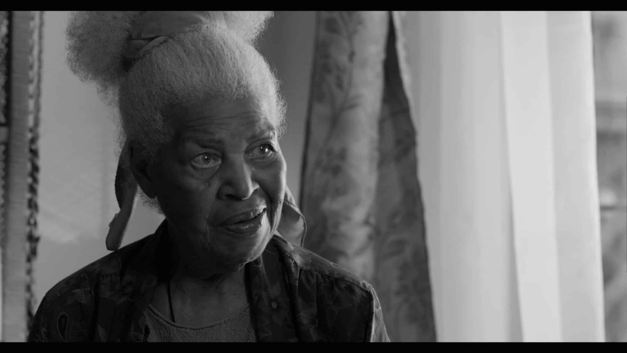 Grandma (Dorothi Fox) sitting at home.