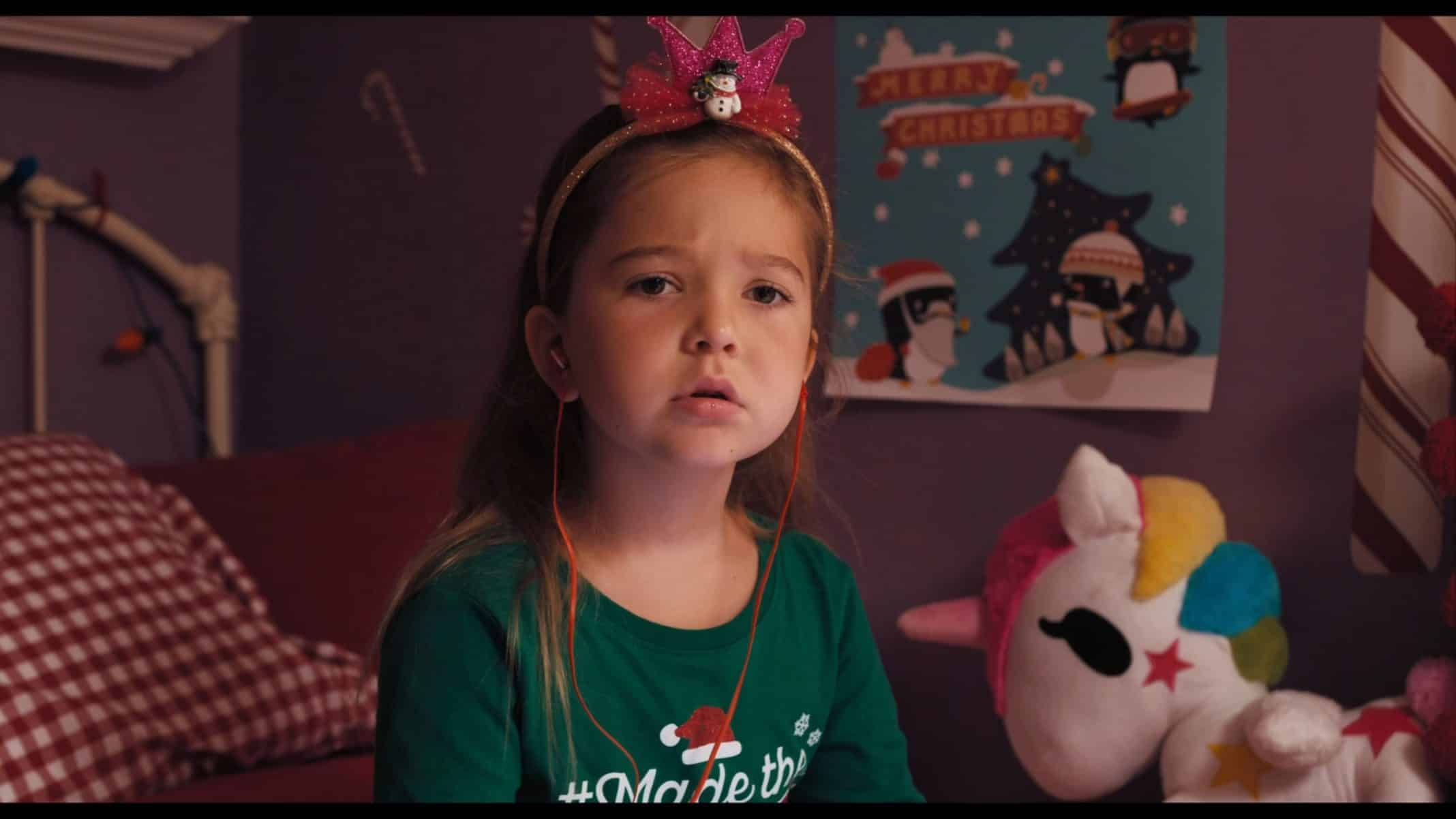 Jennifer (Poppy Gagnon) in a Christmas outfit.
