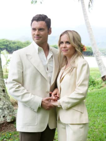 Jorge (Adan Canto) and Leslie (Radha Mitchell) on their wedding day.