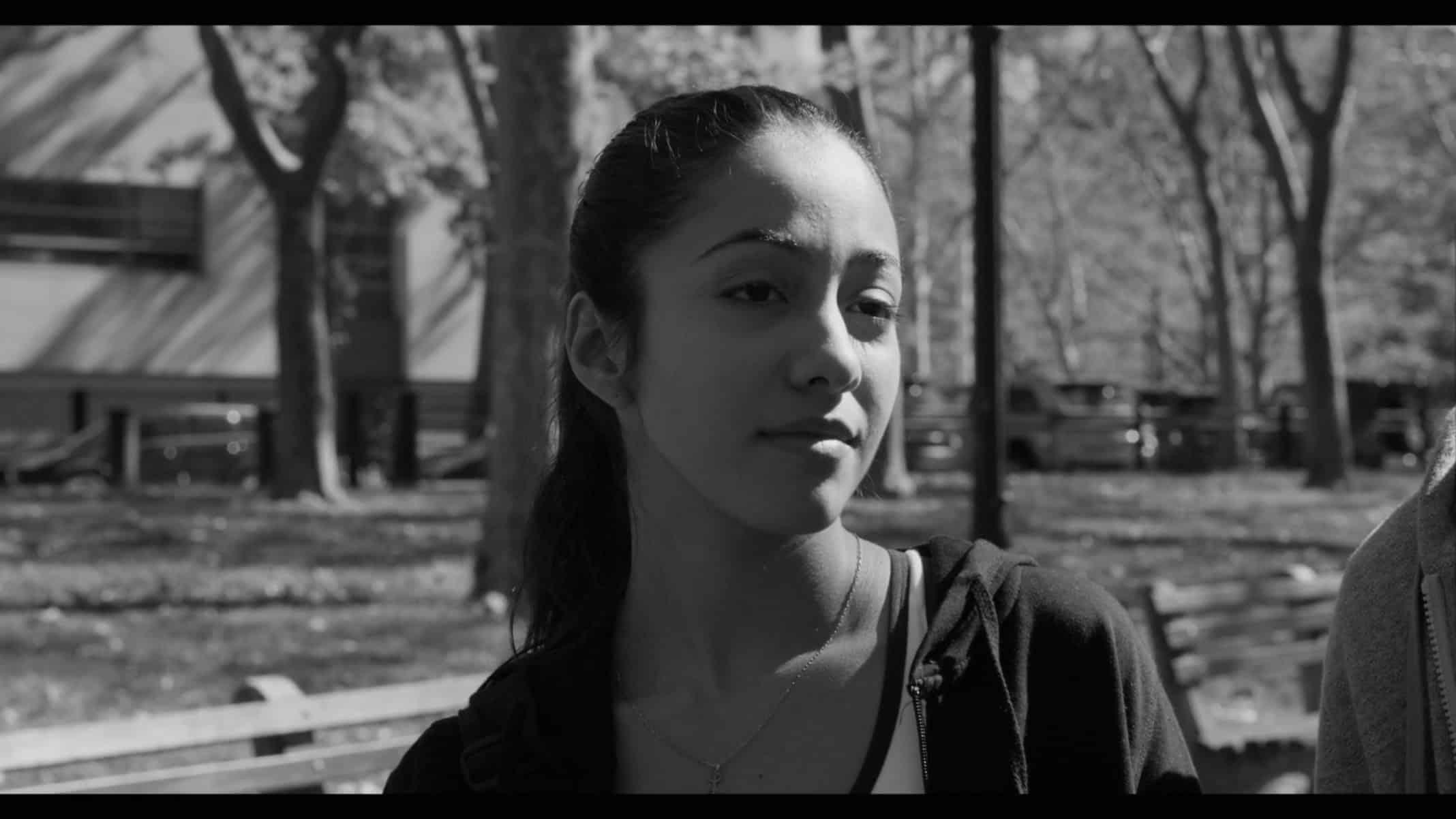 Liza (Shyrley Rodriguez) walking and talking with Max.
