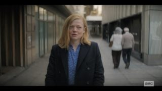 Nicola (Sarah Snook) walking on the street.