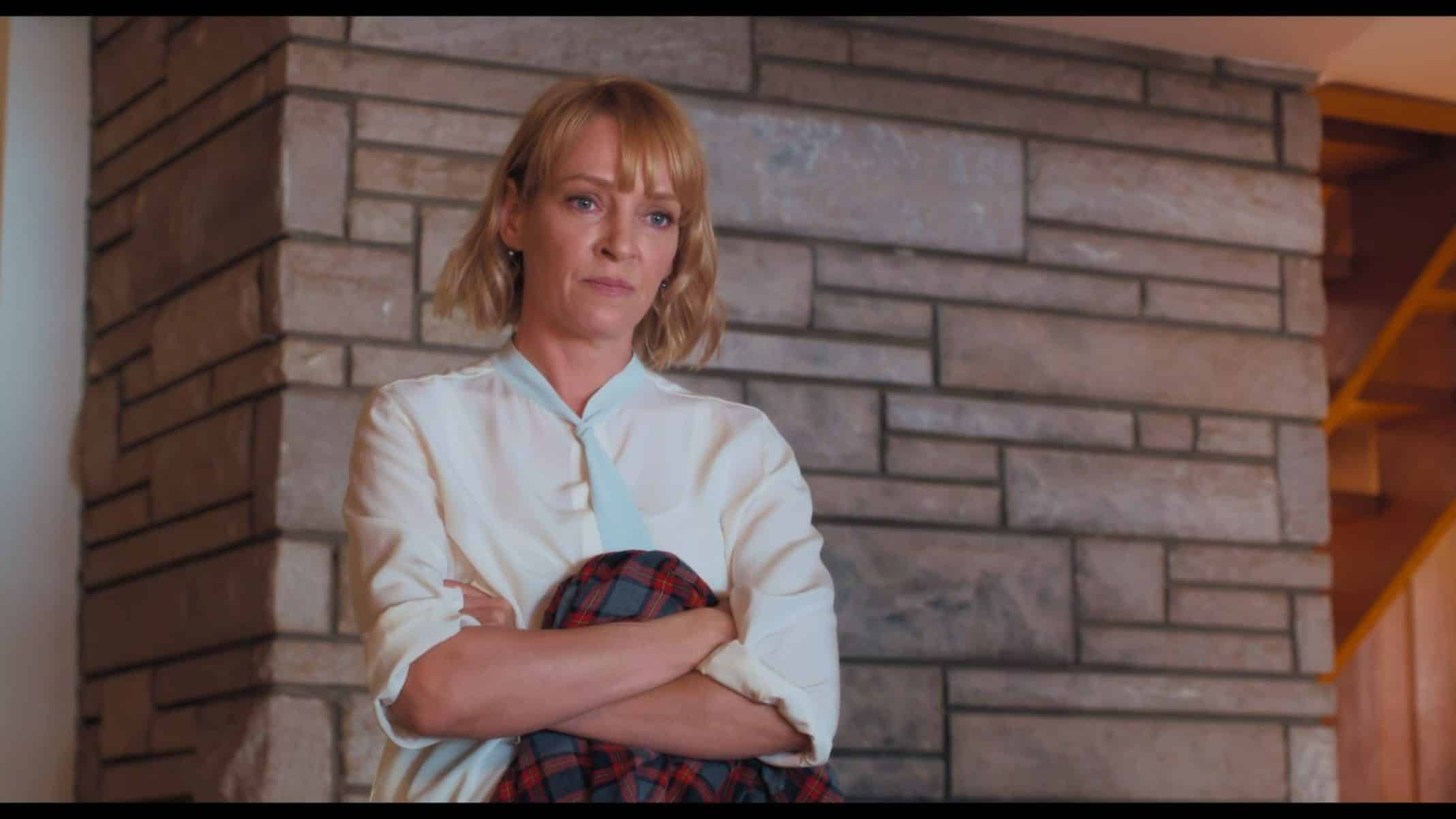 Sally (Uma Thurman) reprimanding Ed.
