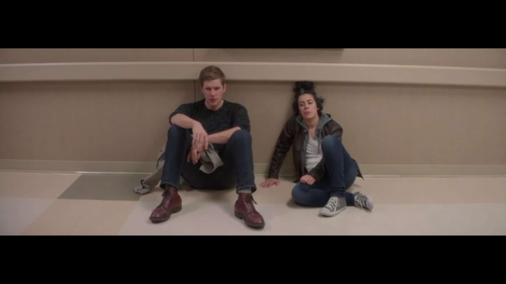 Spencer (Zachary Spicer) and Lex (Roberta Colindrez) sitting on the floor.