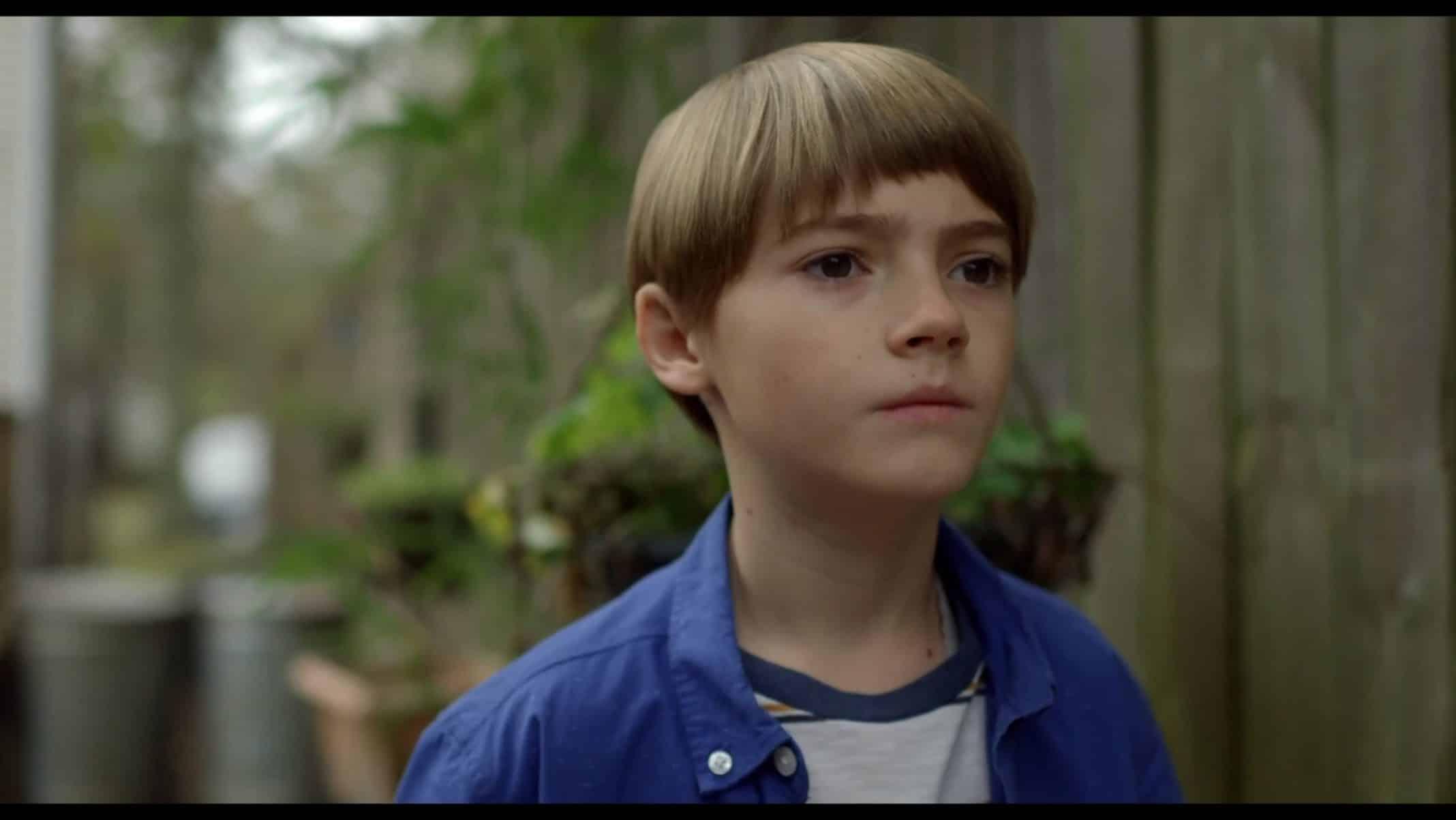 Tate (Jackson Robert Scott) looking forward.