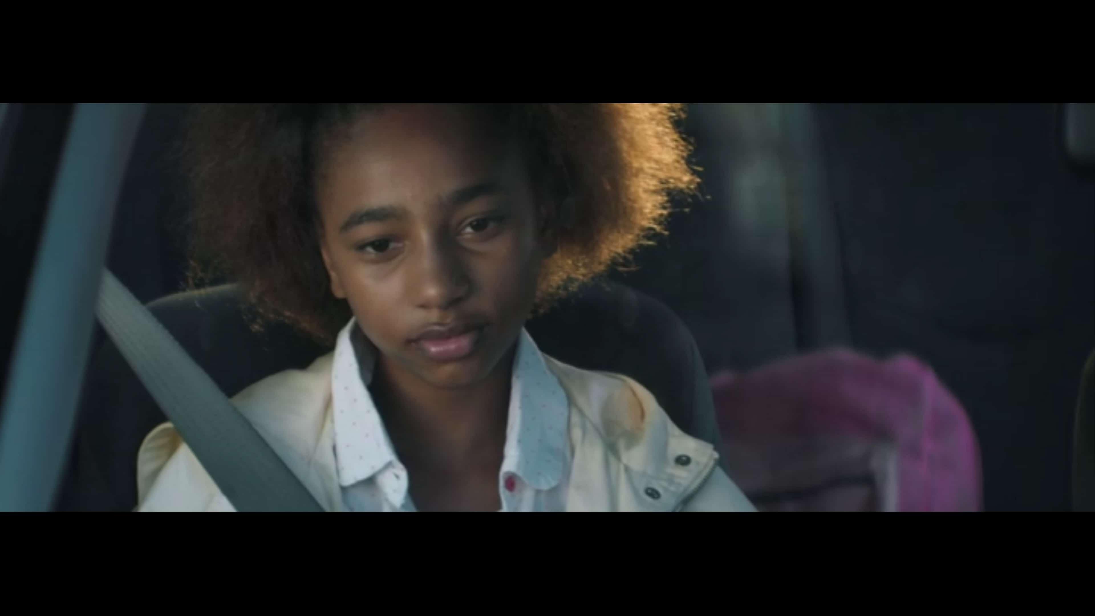 Alicia (Tayler Buck) sitting in a car