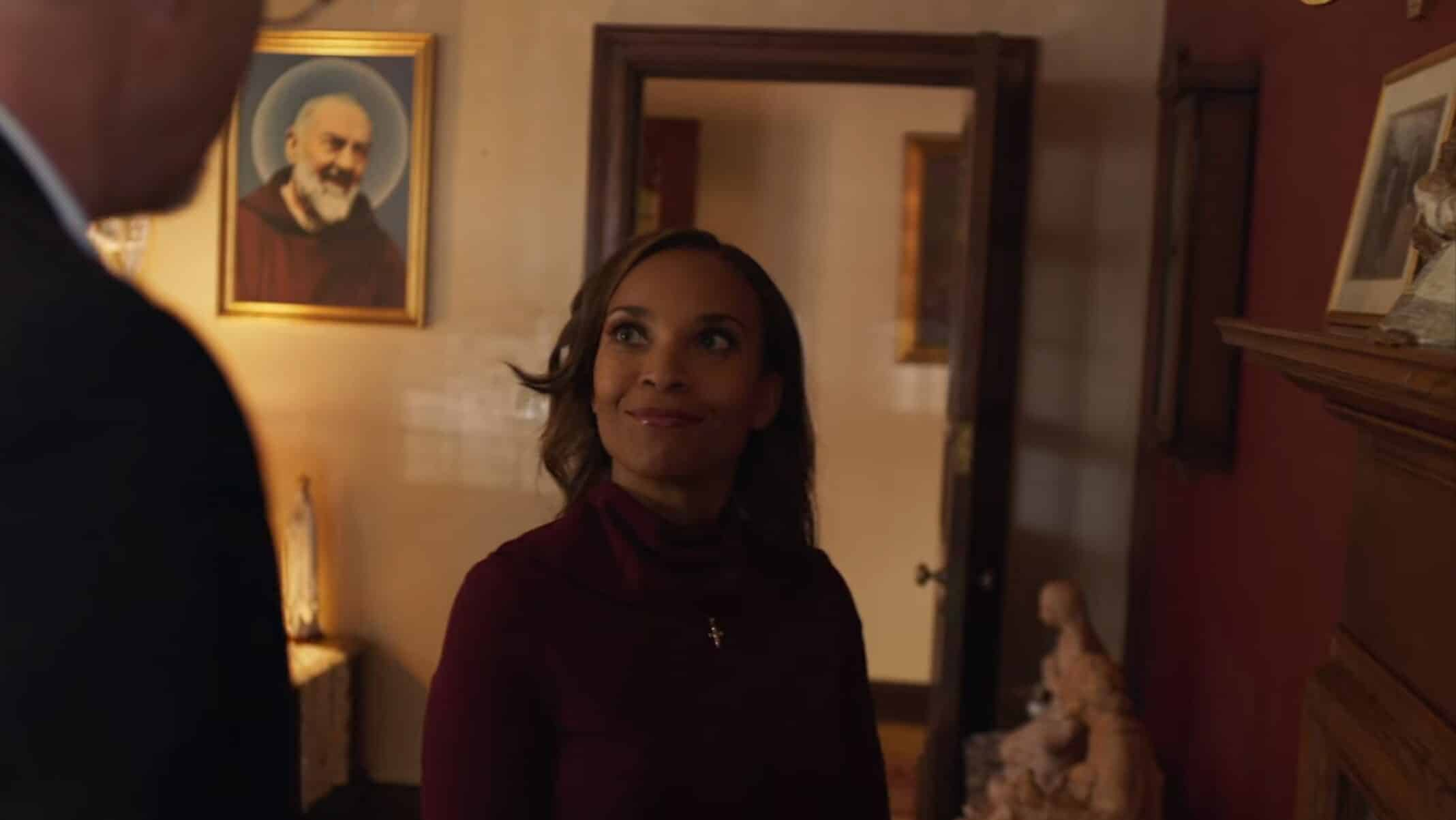 Jennifer 2019 (Nia Fairweather) talking to her church's Father