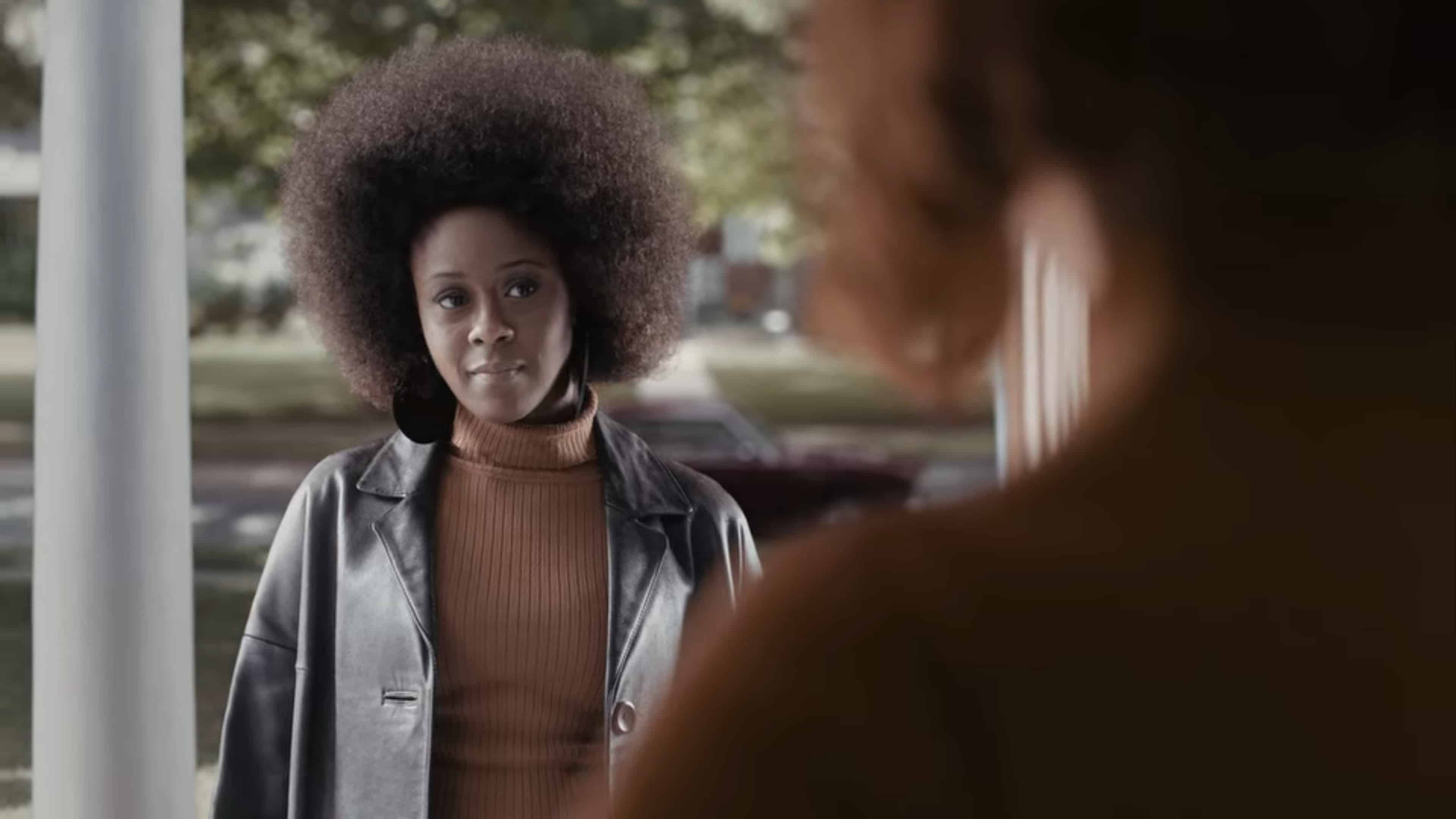 Jolene, with a giant fro, showing up at Beth's door.