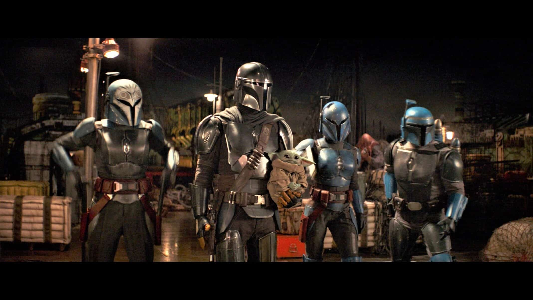 Axe (Simon Kassianides), Bo-Katan (Katee Sachoff), Koska Reeves (Mercedes 'Sasha Banks' Varnado) and Din standing together