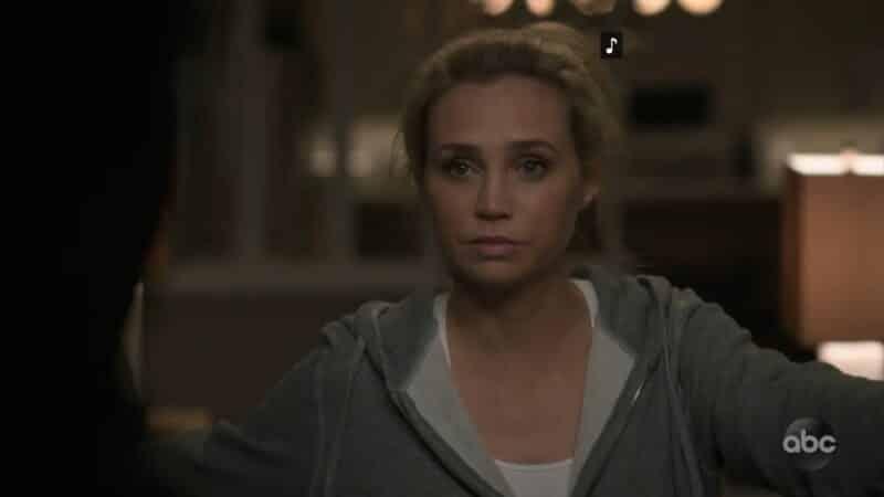 Morgan, at her doorway, looking comfortable.