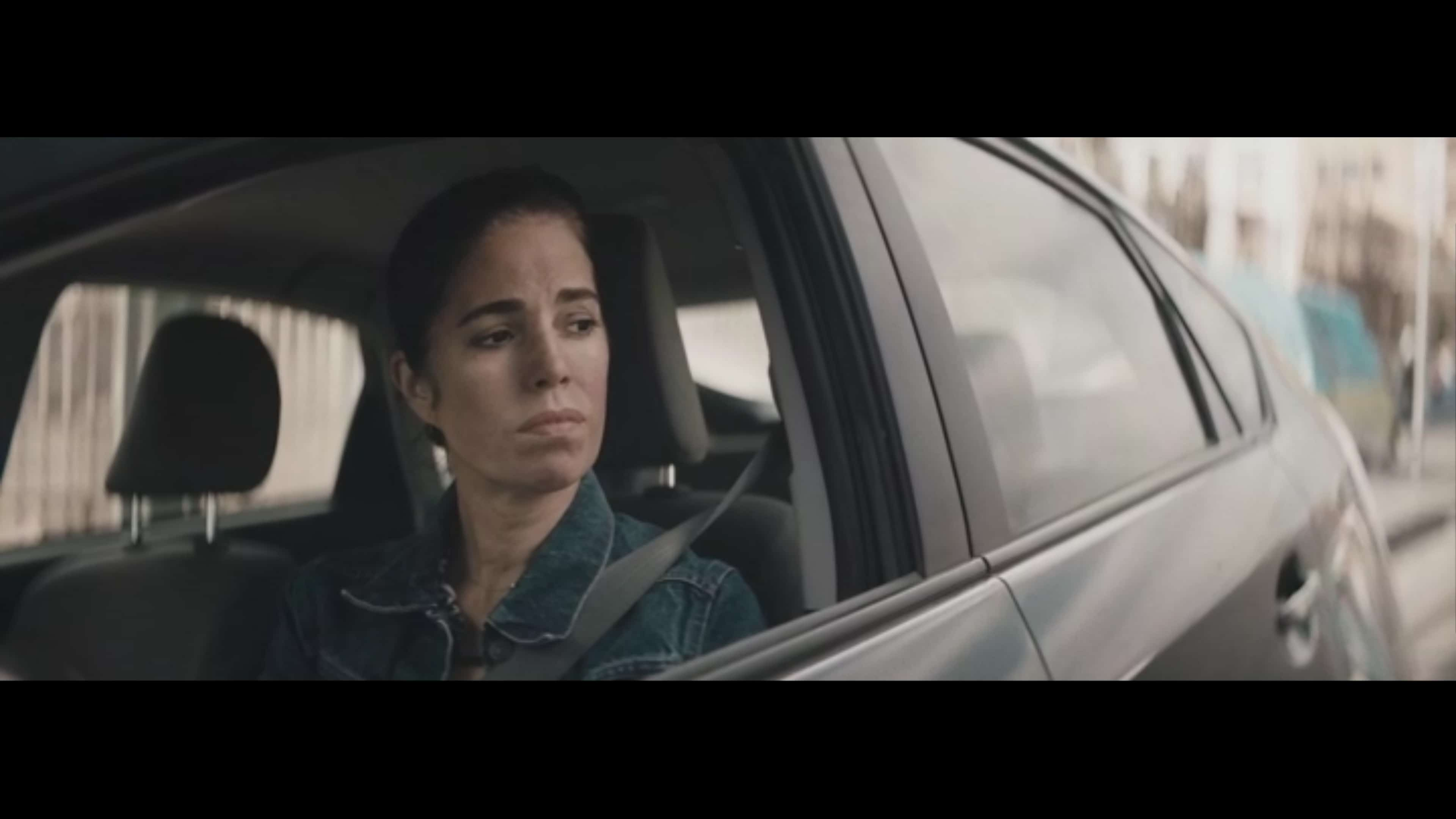 Ms. Rodriguez (Ana Ortiz) looking out the driver's side window.