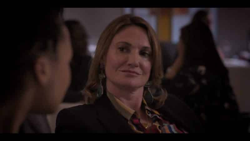 Nicole (Sarah Parish) in a dinner meeting