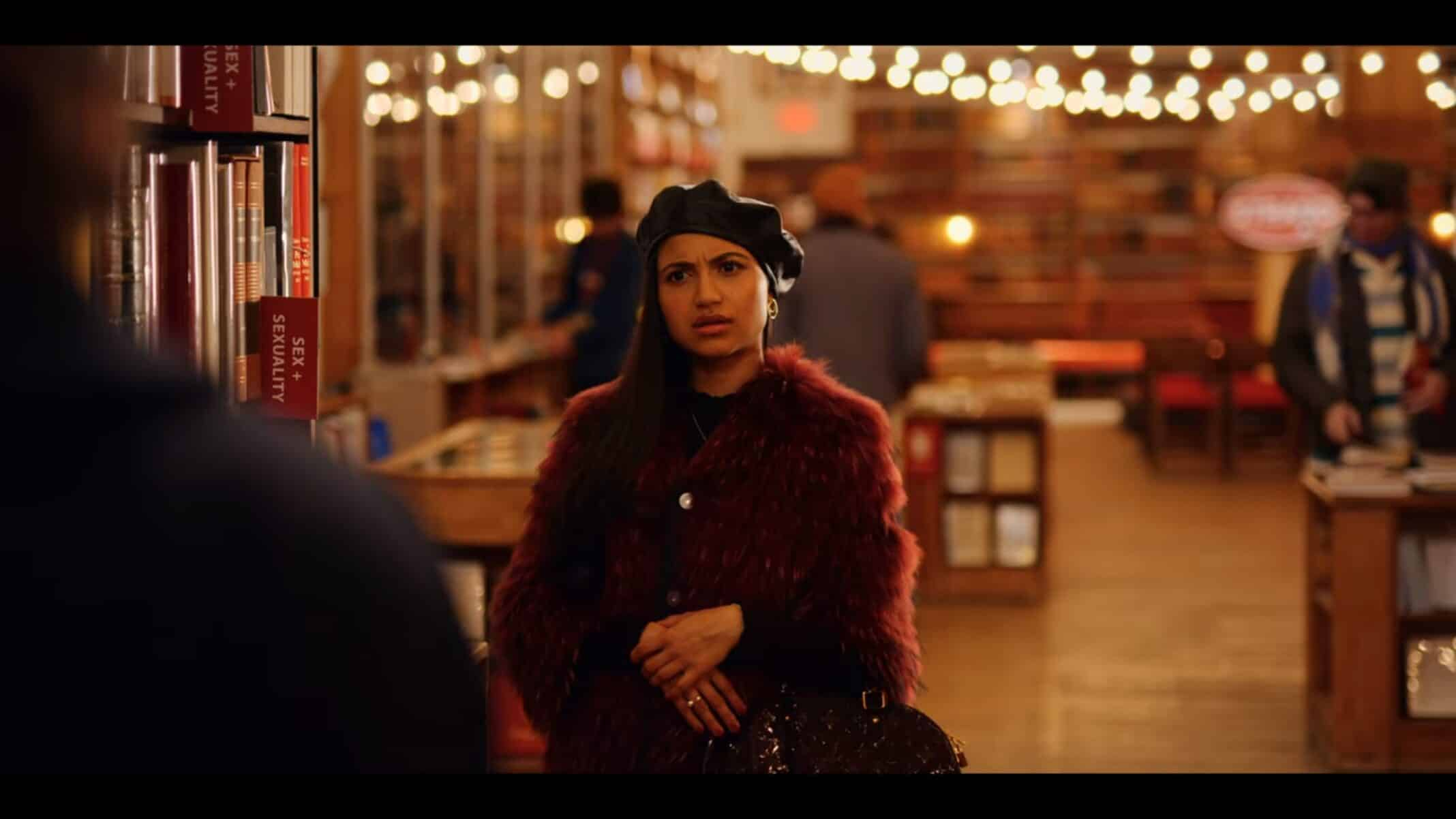 Priya (Agneeta Thacker) seeing Dash with a gay book in his hand