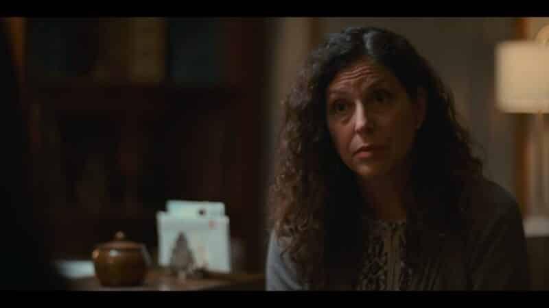 Rabbi Schultz (Lynn Weintraub) talking to Leila