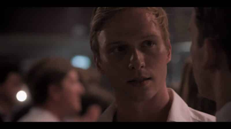Theo (Will Tudor) in a party