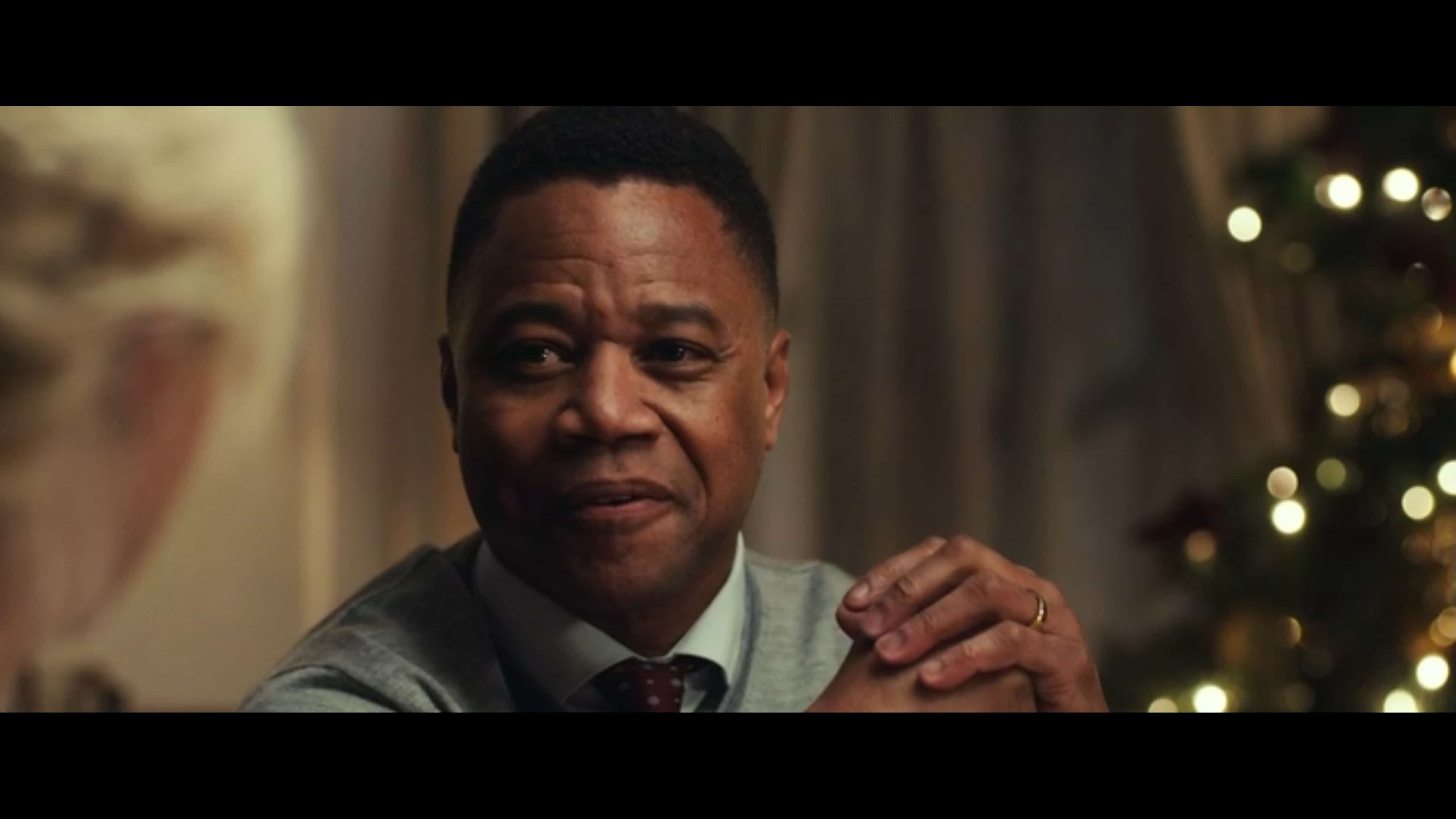 Xavier (Cuba Gooding Jr.) talking down to Isabelle