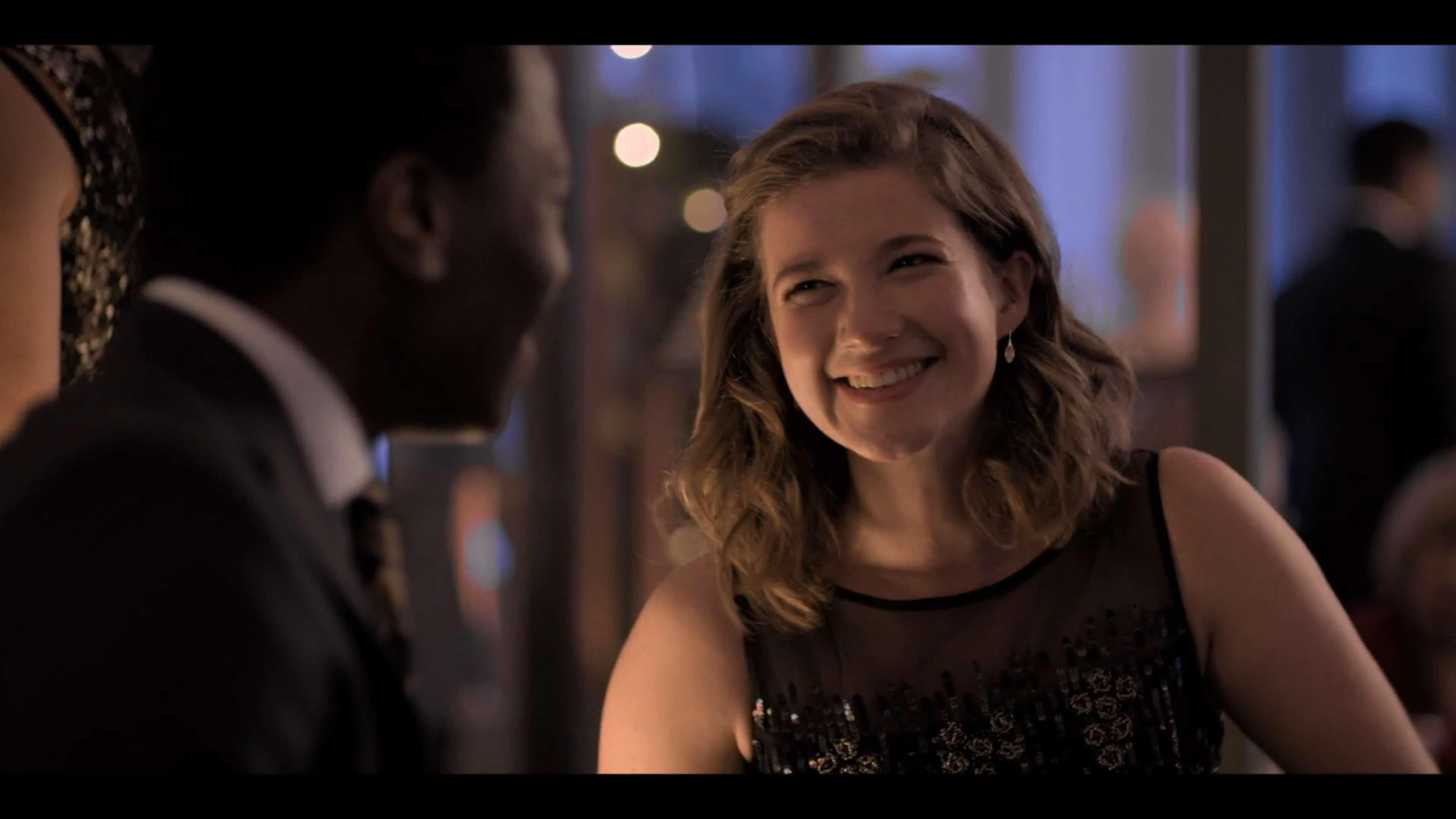 Alice (Karen Fishwick) smiling and joking with Gus