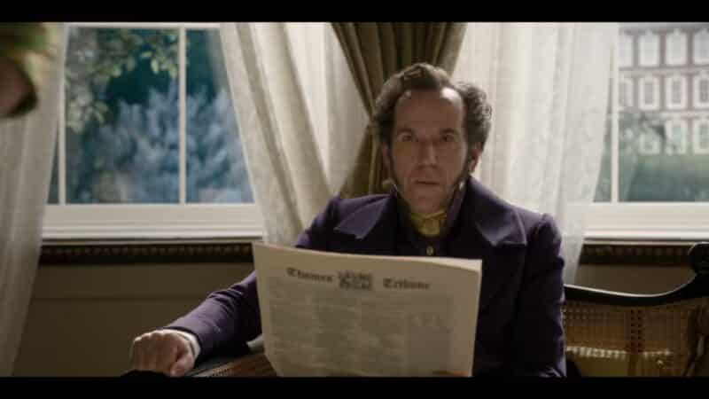 Archibald Featherington (Ben Miller) reading the paper