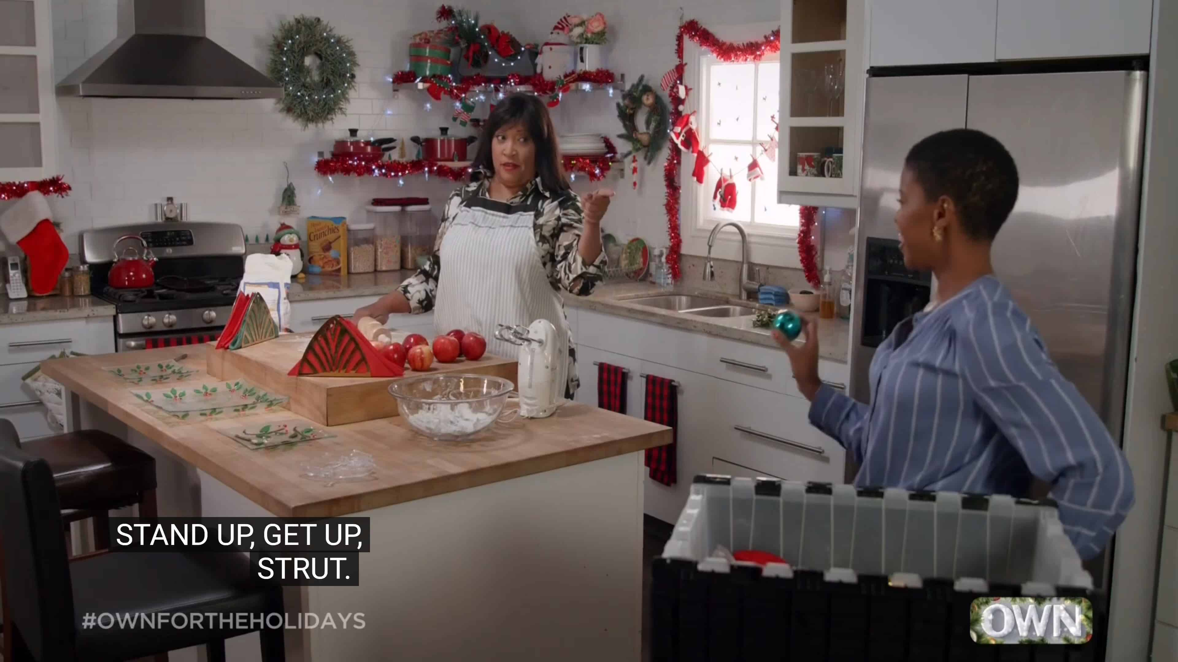 Debbie (Jackée Harry) and Lena (Morgan Dixon) talking in the kitchen