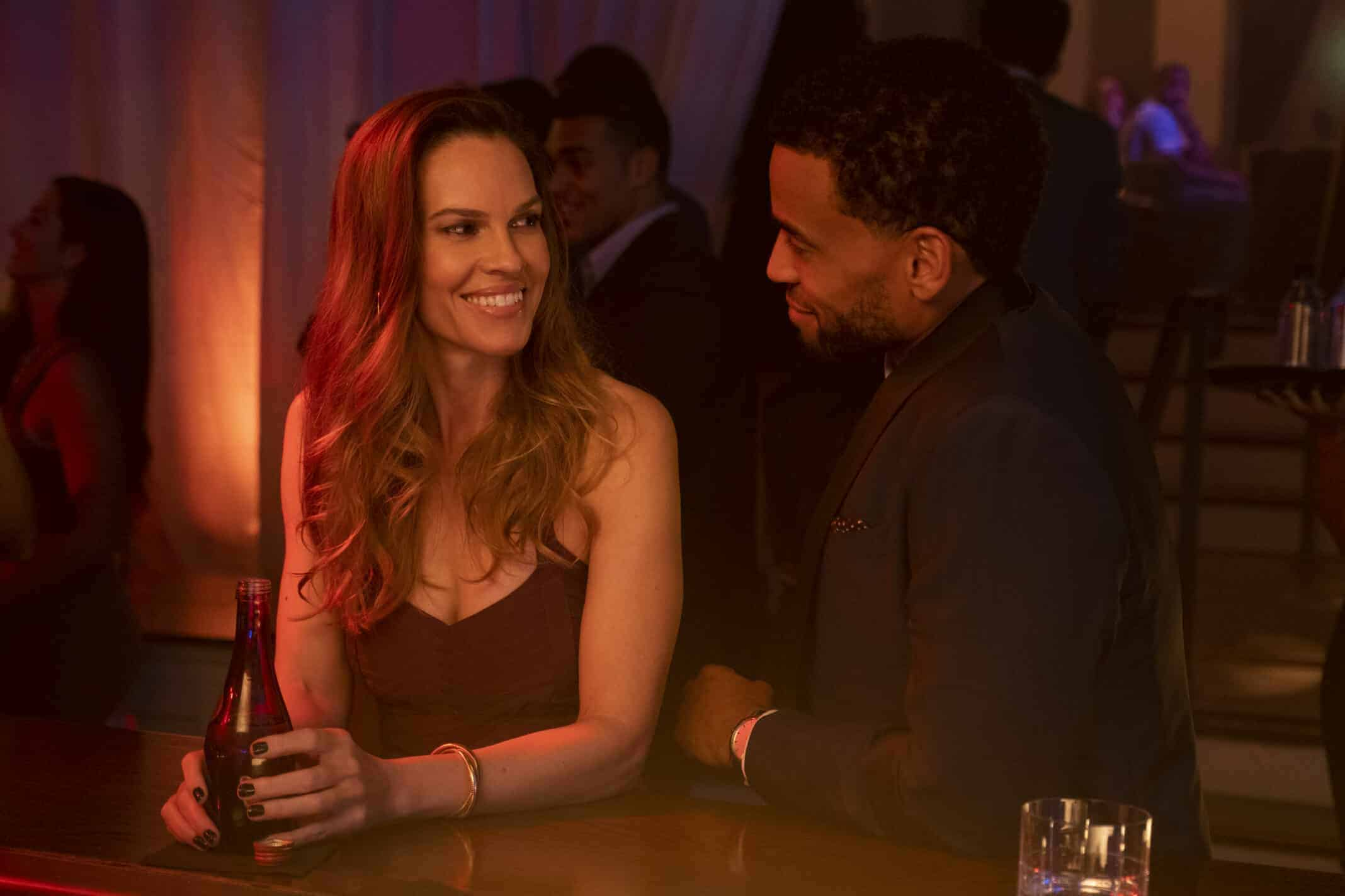 Detective Valerie Quinlan (Hilary Swank) and Derrick Tyler (Michael Ealy) at a bar together