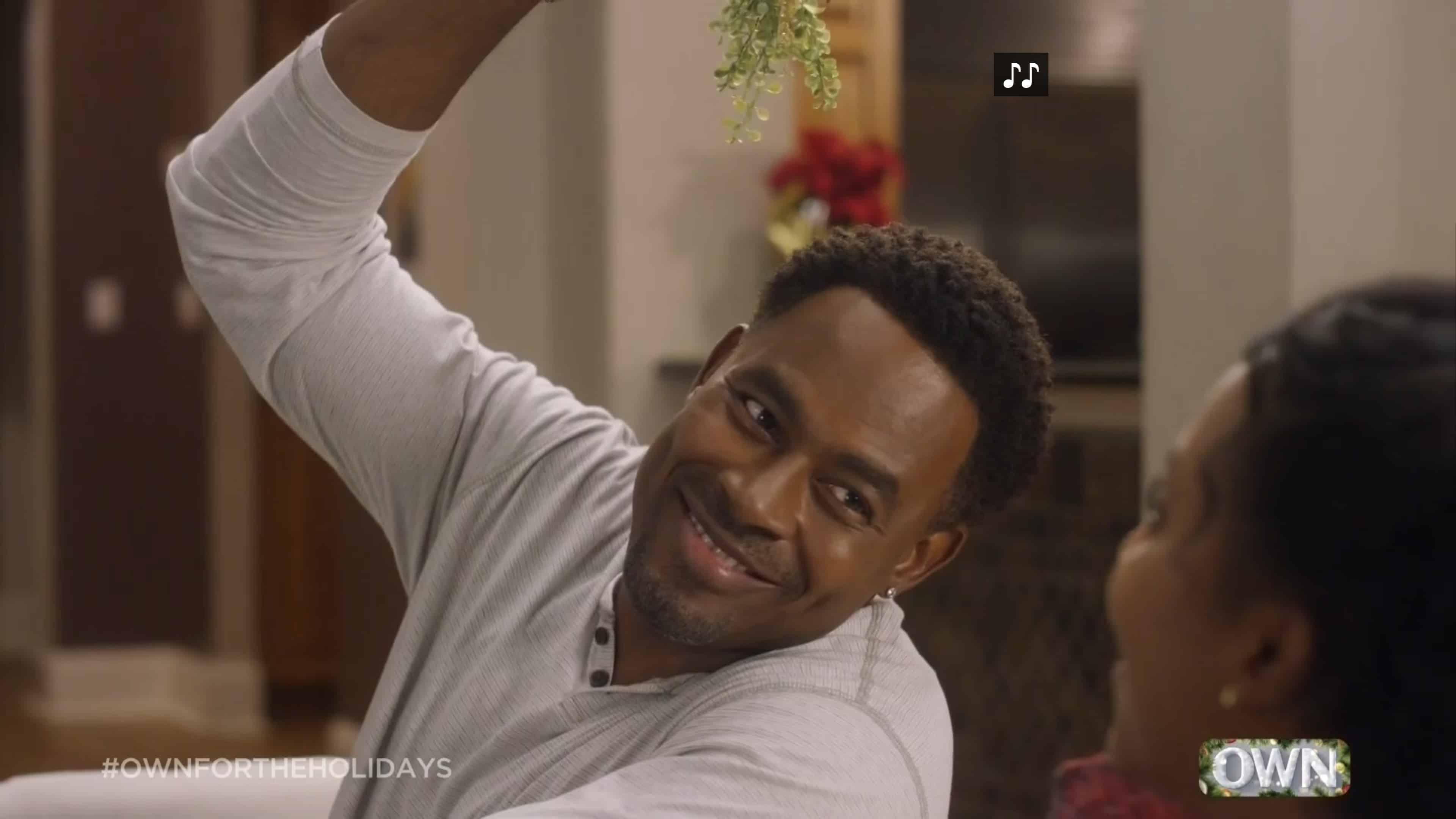 Donovan (Lamman Rucker) holding a mistletoe.