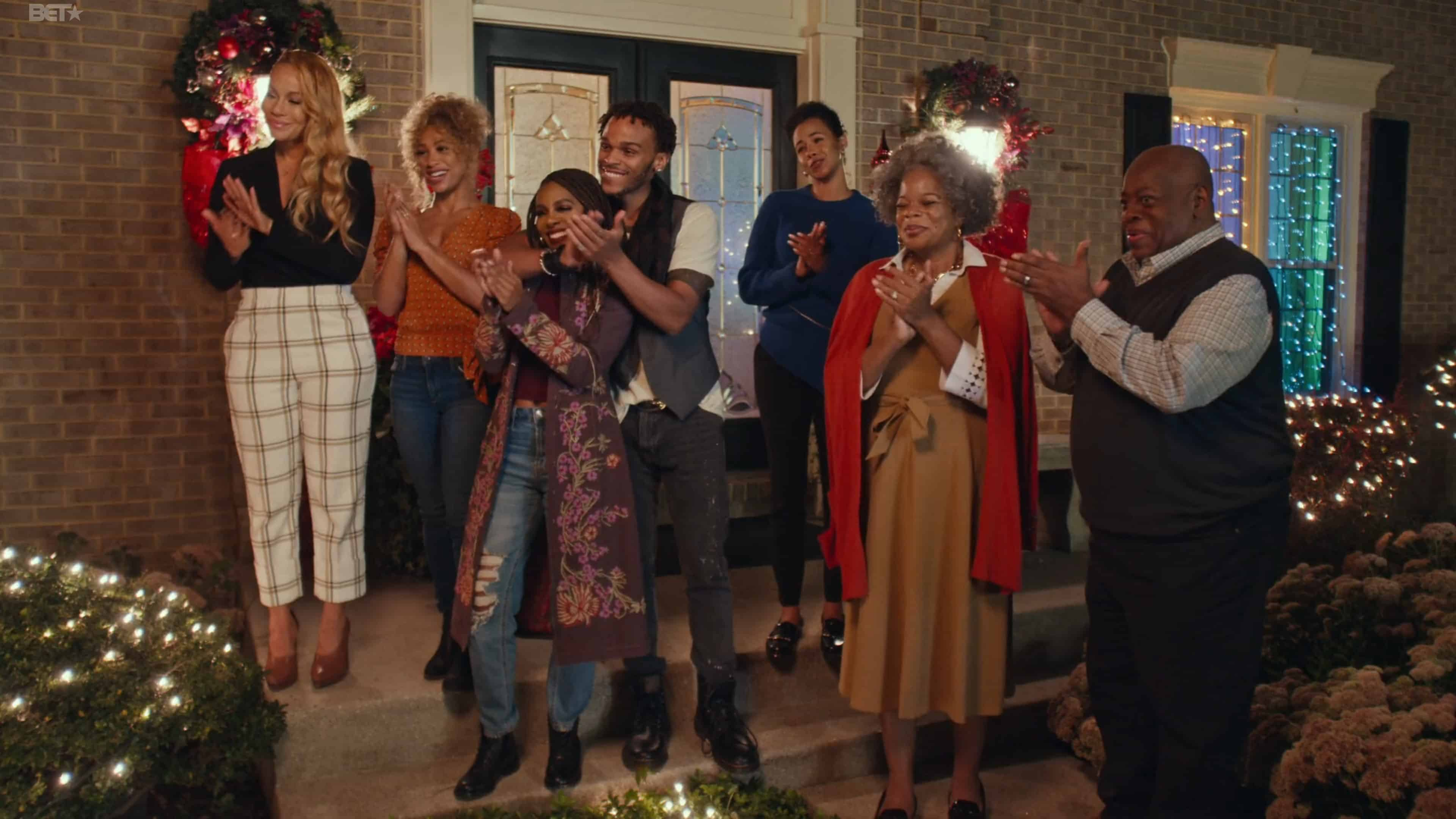 Nicole (Brave Williams), Diedre (Asia'h Epperson), Tammy (Candiace Bassett), Spyder (Terayle), Belinda (Phylicia Morgan), Diane (Kay-Megan Washington), and Gerald (Reginald VelJohnson) clapping for carolers