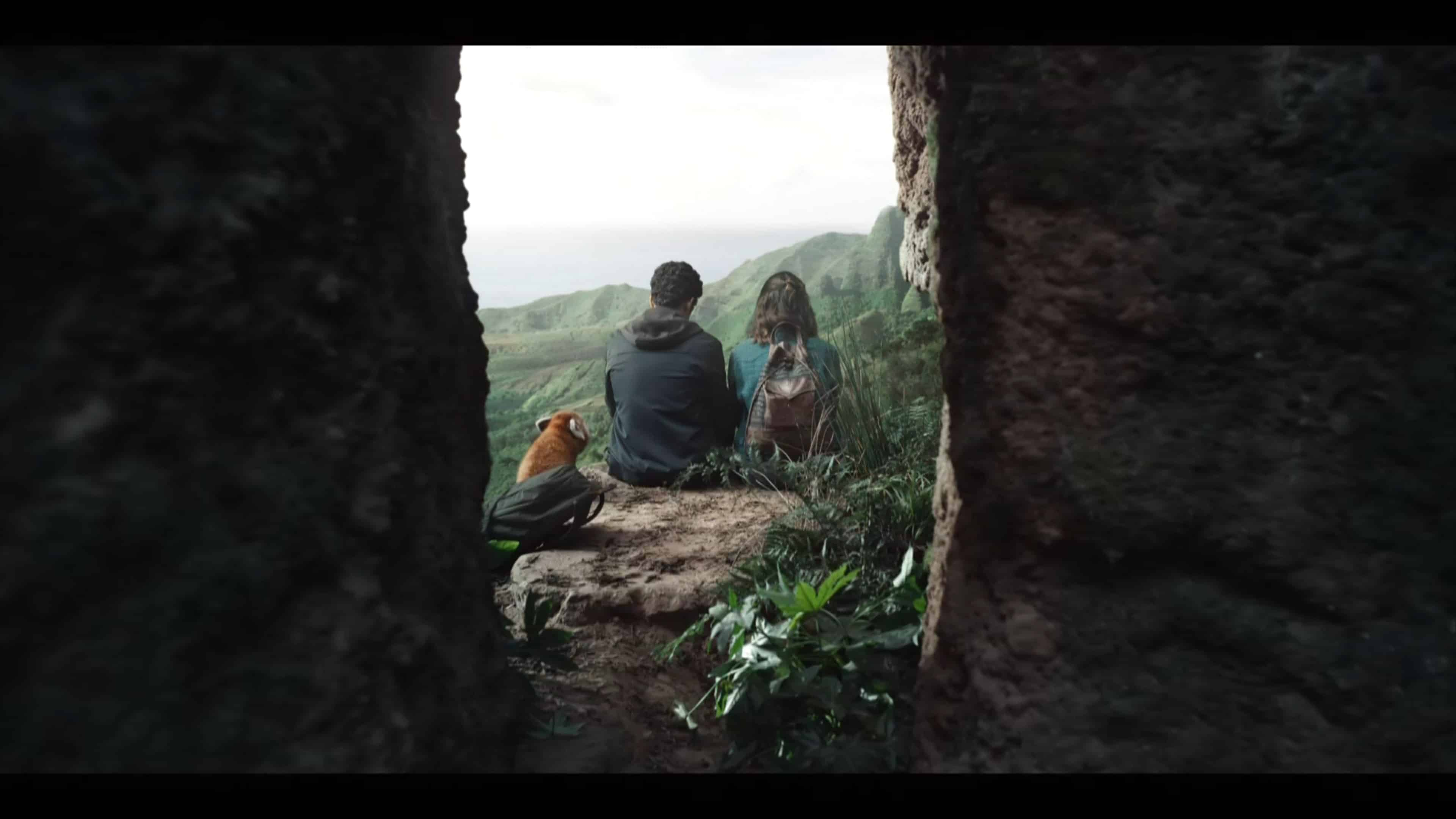 Pan, Will, and Lyra sitting on a cliff